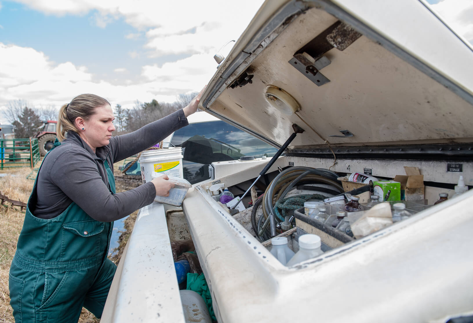 Katie Lang prepares to make a visit at a farm. Her truck is a mobile medical office that holds all the tools and medicines needed to help animals.