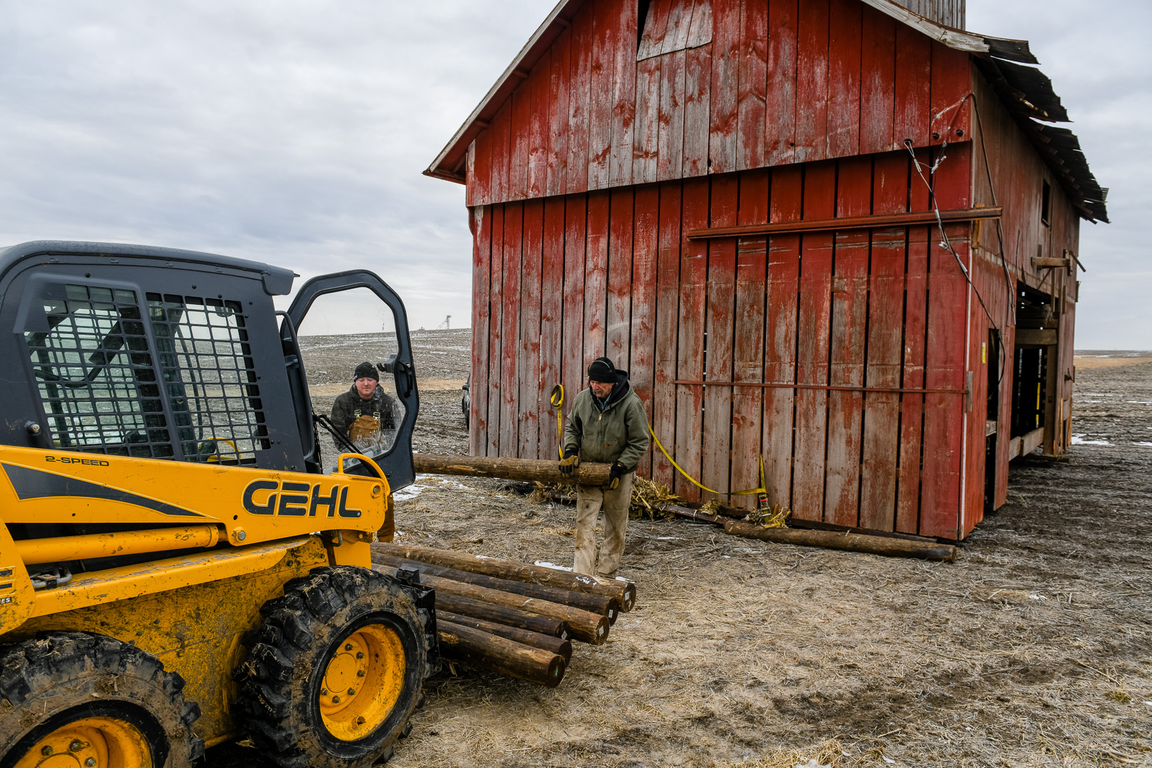 The crew used wooden logs and a steel frame to move the barn across the ground. Stopping often to collect the rollers and place them in the front to start the process over.