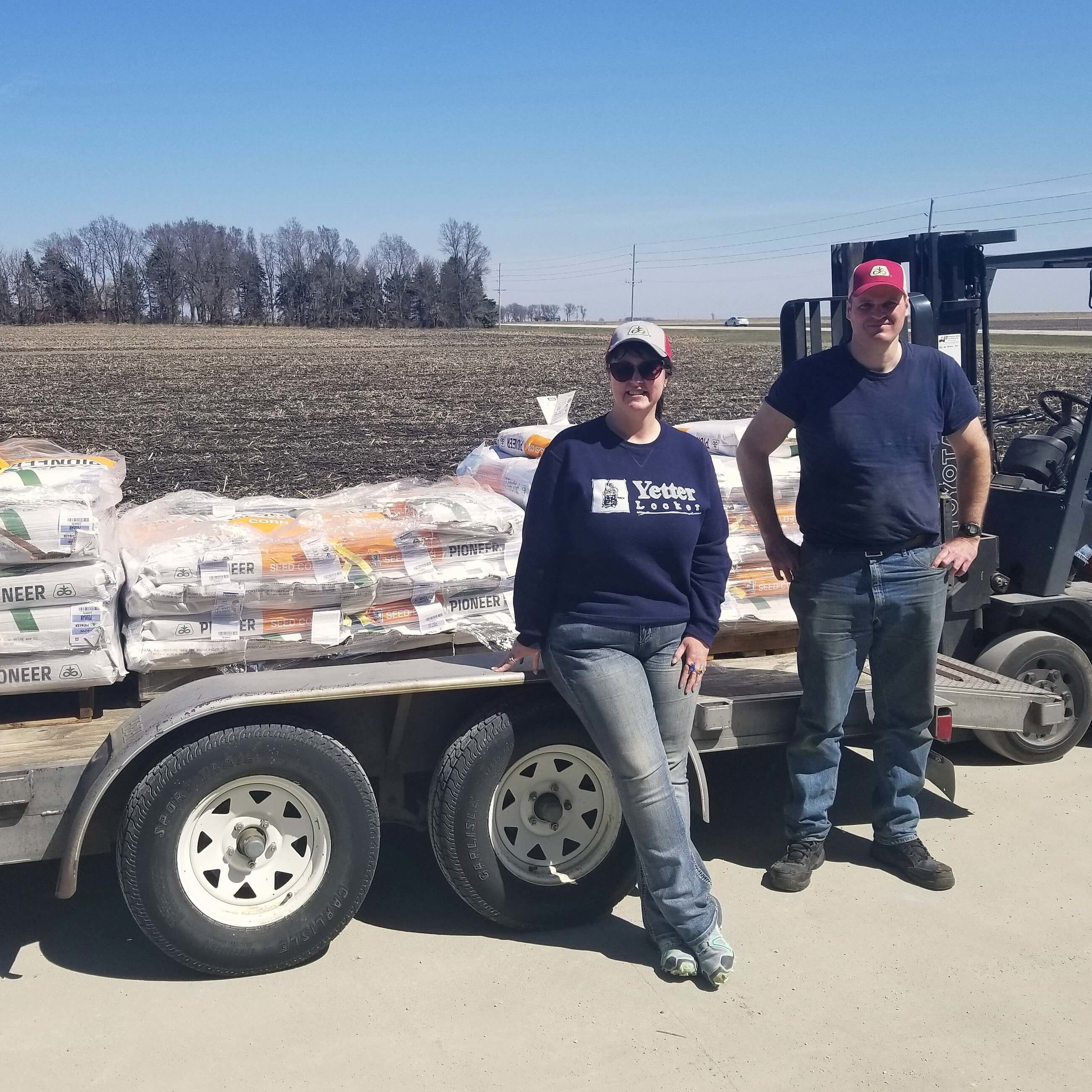Darcy and her brother, Jason, pick up seed as planting season begins.