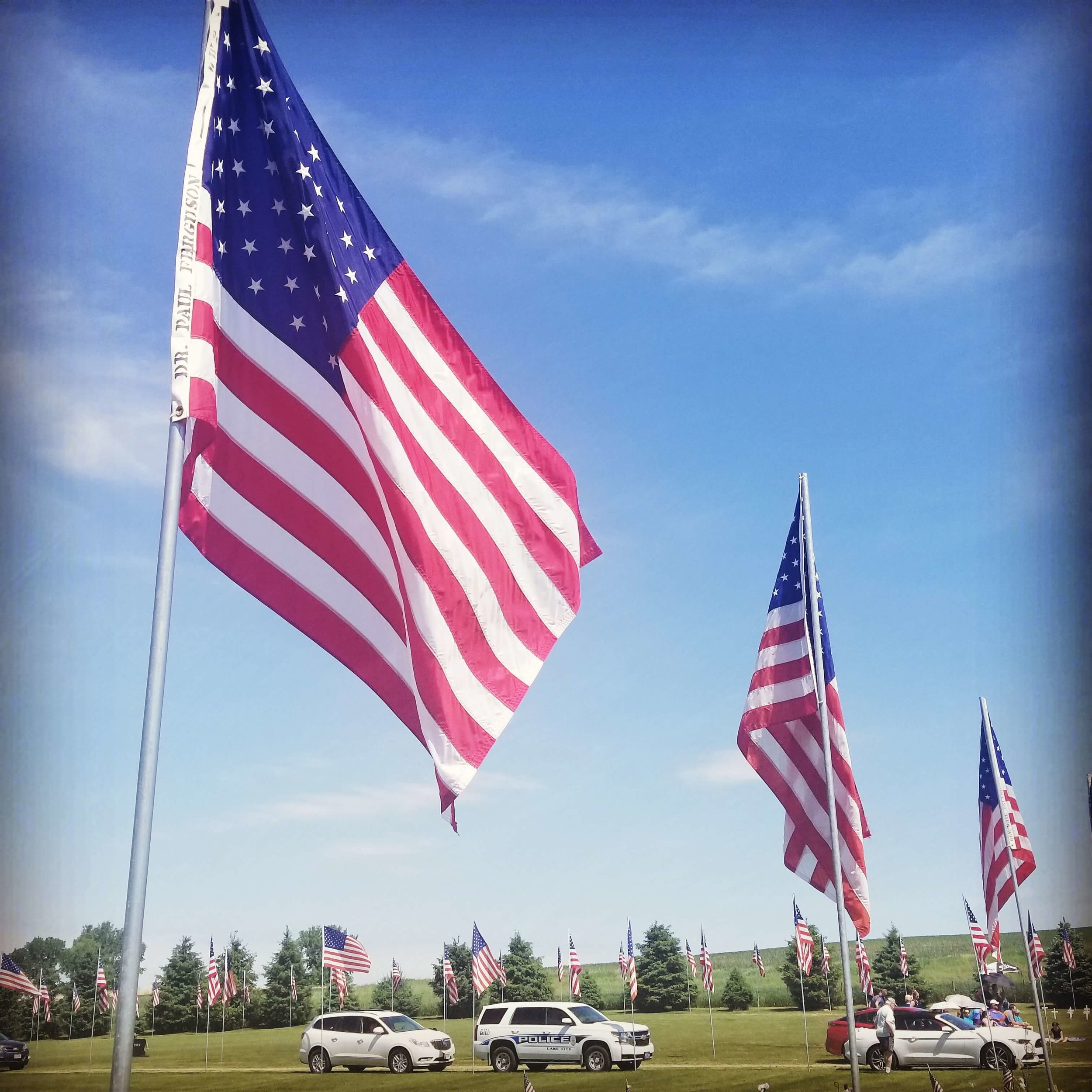 Flags displayed at the Memorial Day ceremony honor veterans Darcy knew personally, like this one for Dr. Paul Ferguson.