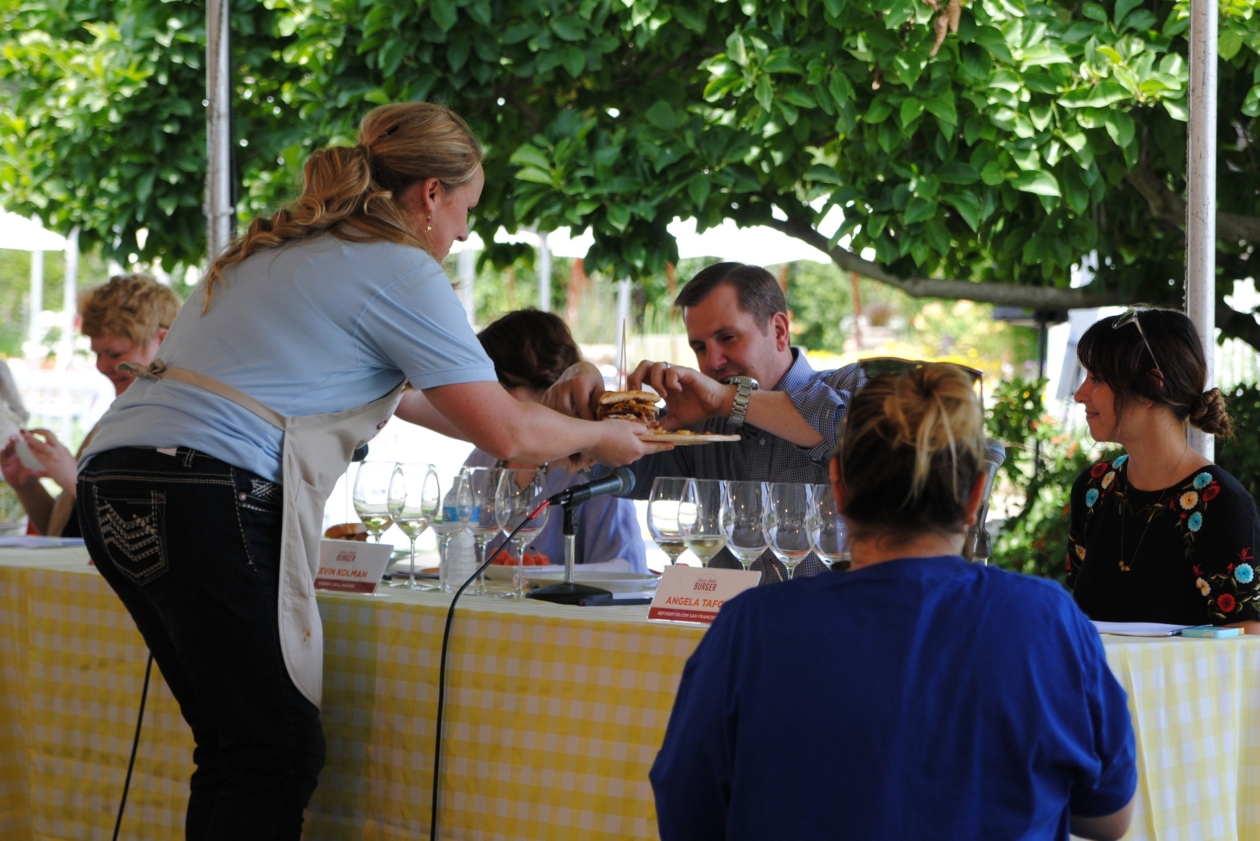 Cristen Clark shares her winning pork burger with Kevin Kolman during the Sutter Home Build a Burger Contest.