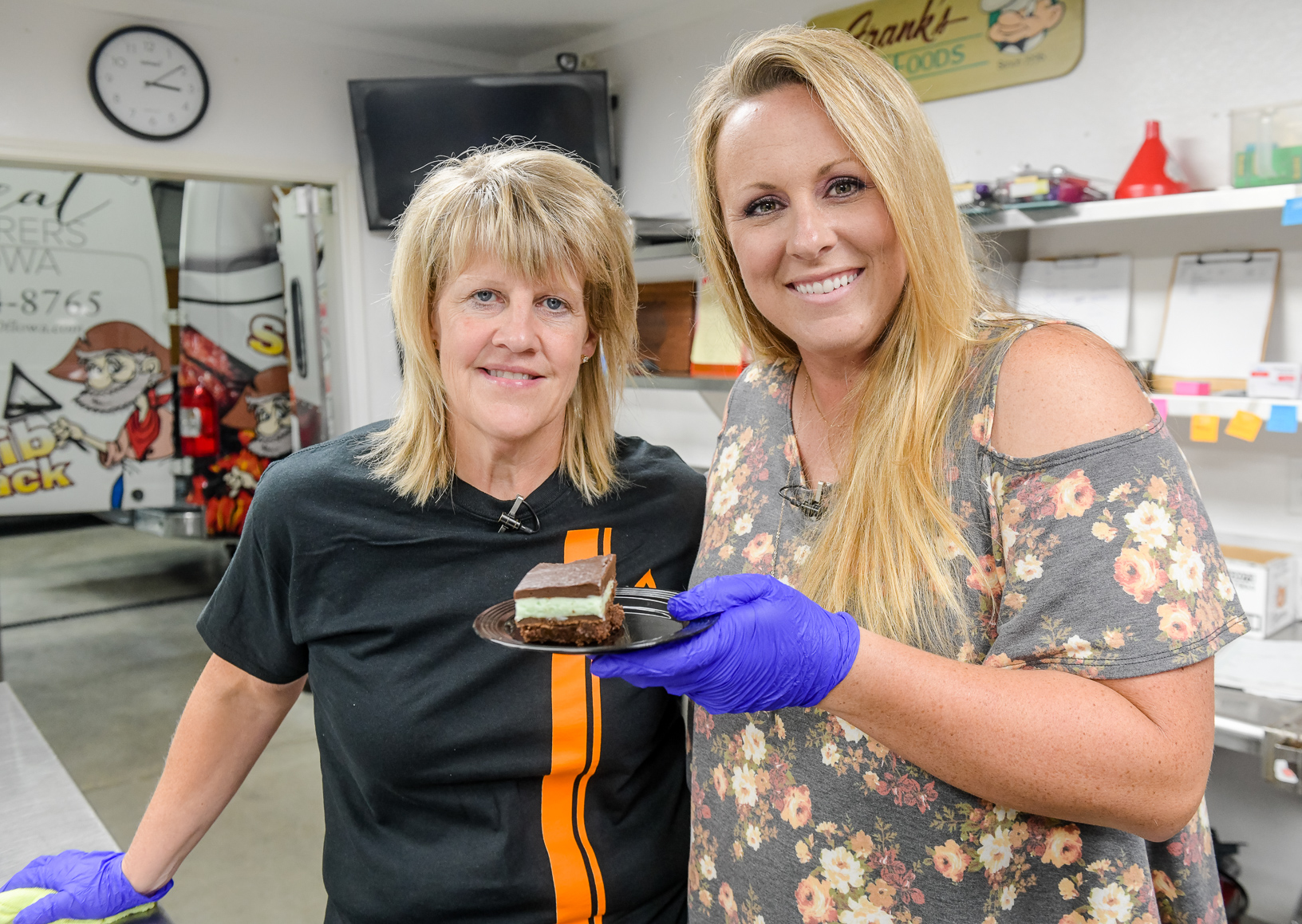 Joni Bell and Cristen Clark dig in to a creme de menthe brownie. hoto credit: Joseph L. Murphy/Iowa Soybean Association