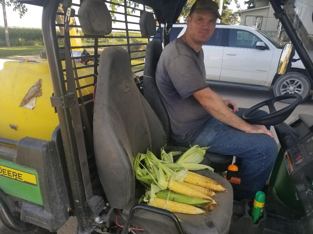 Darcy's brother Jason brings home fresh-picked sweet corn. Photo credit: Darcy Dougherty Maulsby