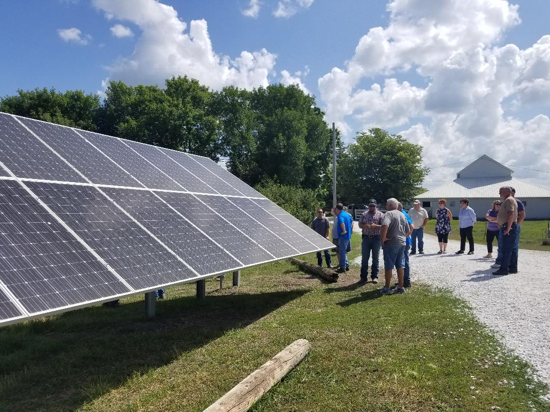 Dwight Dial shares about his new solar array during a conservation field day. Photo credit: Darcy Dougherty Maulsby