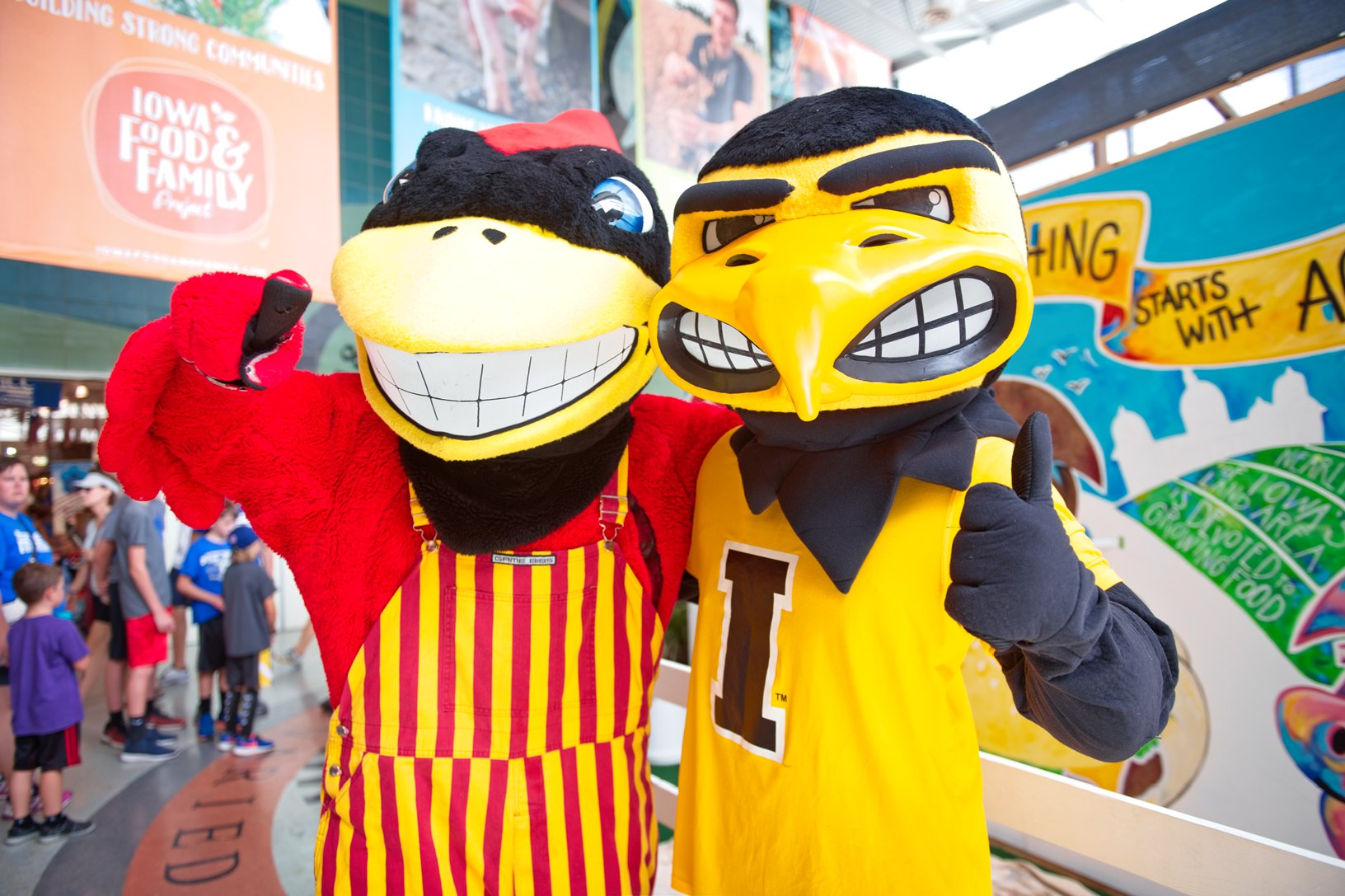 Cy and Herky spark up a fierce rivalry and share their artistic skills to help complete the 'Everything Starts with Agriculture' mural. Photo credit: Joseph L. Murphy/Iowa Soybean Association