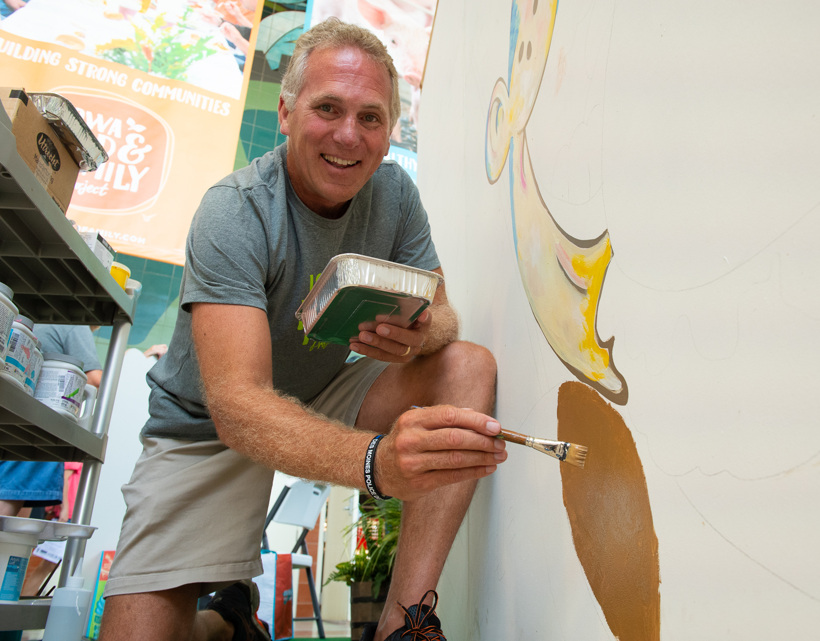 Chuck Long, director of the Iowa Sports Foundation and former University of Iowa football player, lends his artistic skills to star the 'Everything Starts with Agriculture' mural. Photo credit: Joseph L. Murphy/Iowa Soybean Association
