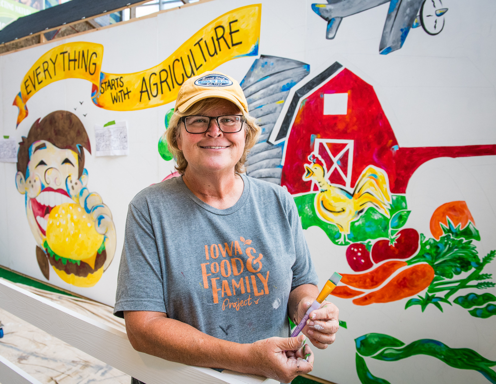 Cate Newberg, marketing director at the Iowa Soybean Association, painted a 'Everything Starts with Agriculture' mural throughout the fair. Photo credit: Joseph L. Murphy/Iowa Soybean Association