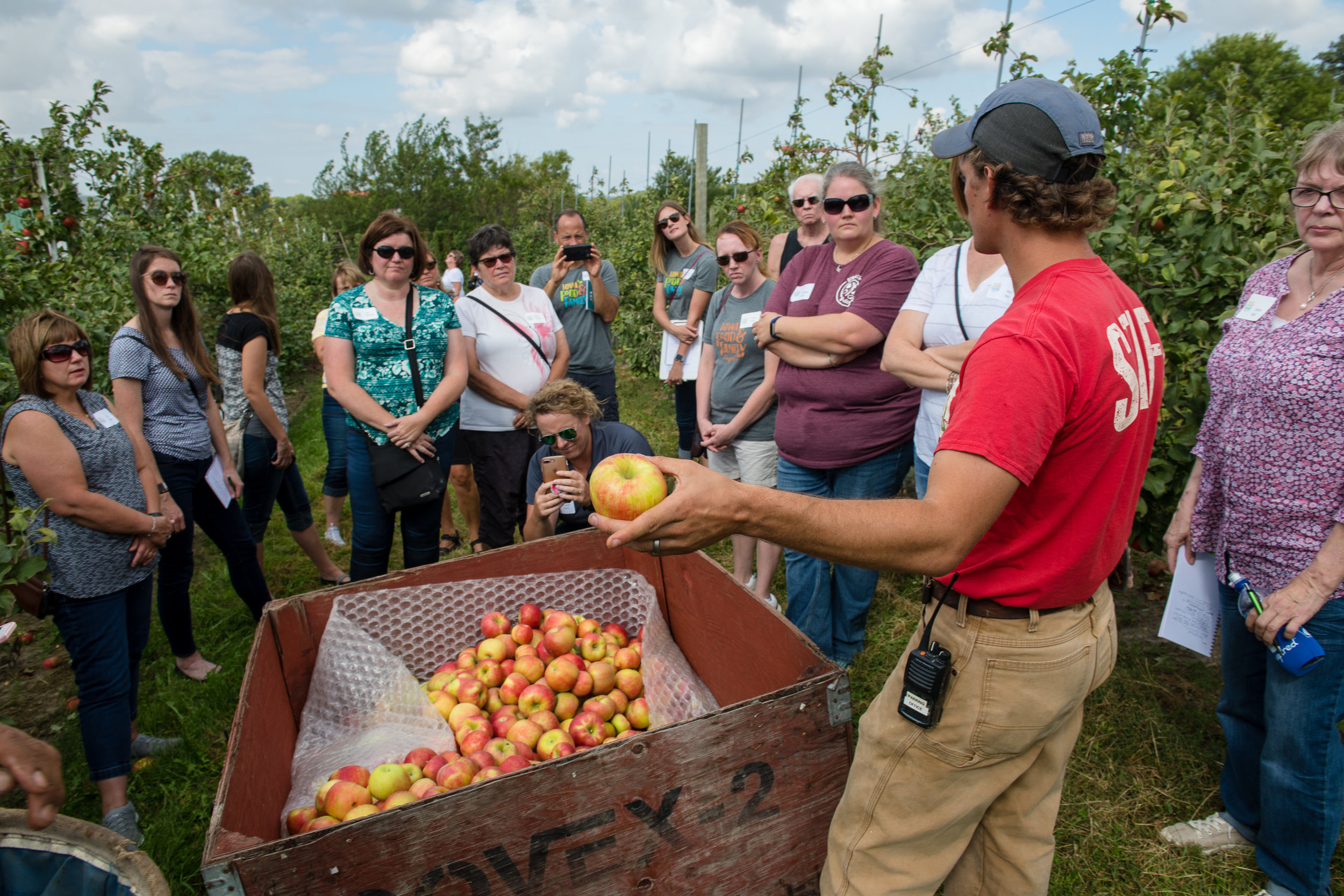 Food U participants spoke with the Center Grove Orchard horticulture supervisor, Brian Shilling. Photo credit: Joseph L. Murphy/Iowa Soybean Association