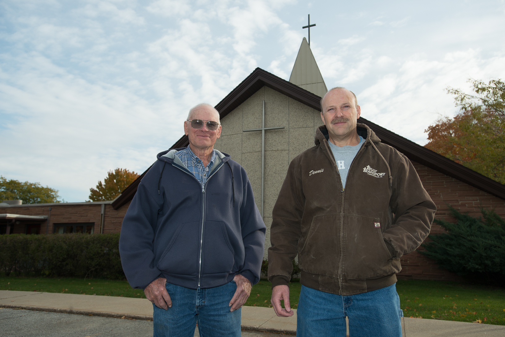 Rolan Jensen (left) and Dennis Lundy stand outside Greenfield United Methodist Church in 2015. They are instrumental in bringing the Fields of Faith project to life each year. Photo credit: Joseph L. Murphy/Iowa Soybean Association.