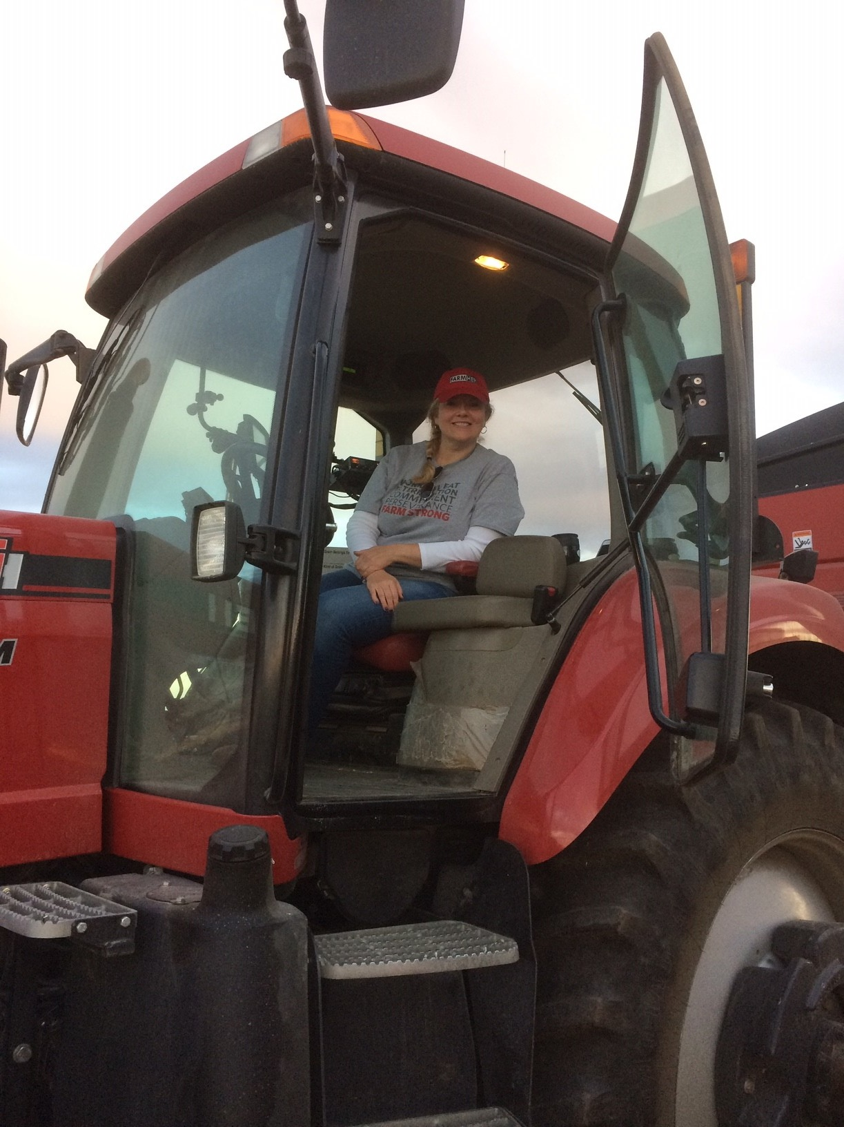 """Susanne in """"her"""" tractor after harvesting corn. Photo credit: Tom Oswald"""