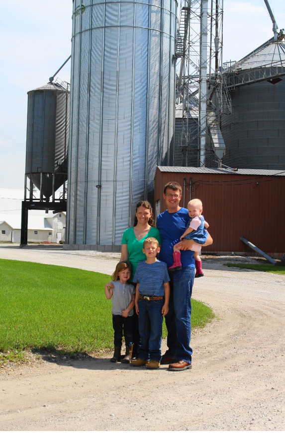 """Nick and Katie were 2018 recipients of the Iowa State Fair's """"The Way We Live"""" award sponsored by Pioneer, Iowa Farmer Today and the WHO BIG show. Presented during the Iowa State Fair, the award recognizes Iowa farm families who have demonstrated their dedication to agriculture and strong Iowa farm values. Photo credit: Iowa State Fair"""