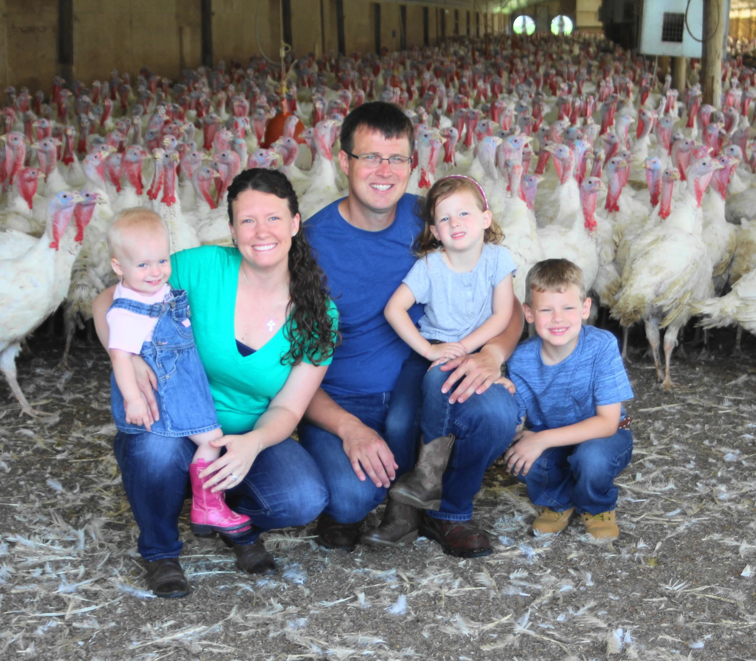 Katie and Nick Hermanson with their children Lucille, 2; Charlotte, 5; Gavin, 7. The Hermansons are fifth generation farmers who live in Story City. Photo credit: Iowa State Fair