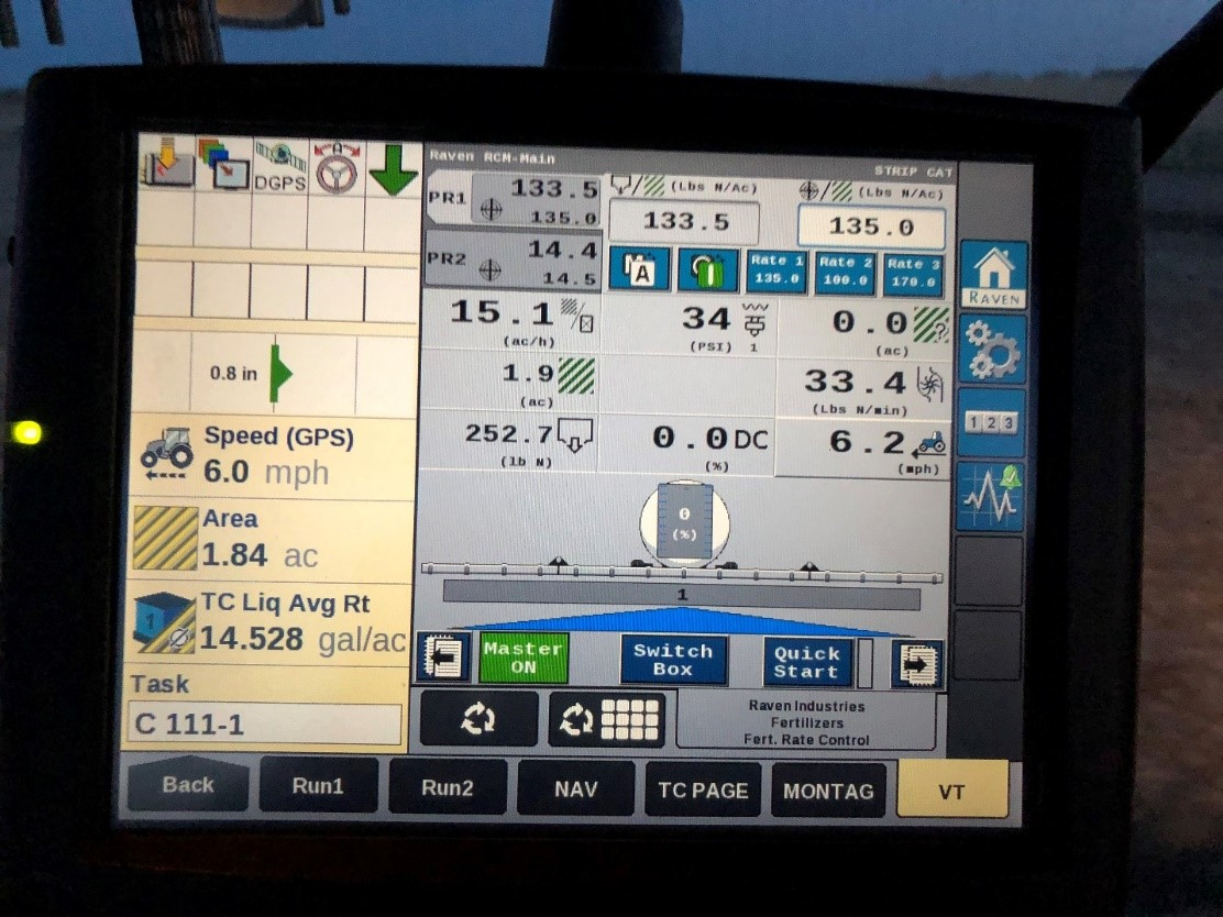 "A photo of what I see while monitoring strip-till fertilizer operations. This monitor can be moved from tractor to tractor and is also used to monitor yield in the combine and act as an interface into the combine itself. The ""TASK"" is how I track anhydrous ammonia nitrogen tanks. I can compare how accurately my system is performing as each tank is weighed back at the elevator. In this case, I am applying my first load from the tank numbered 111 from the elevator in Cleghorn. The nitrogen rate is set for 135#/acre nitrogen and it is running 133.5#/acre at that moment. As speed varies you see a bit of variance, but the system keeps things close as it is continually adjusting to keep rates near my settings. The liquid setting is 14.5 gallons/acre and is running close as well. The control module is from a company call Raven Precision in Sioux Falls, South Dakota. Photo credit: Tom Oswald"