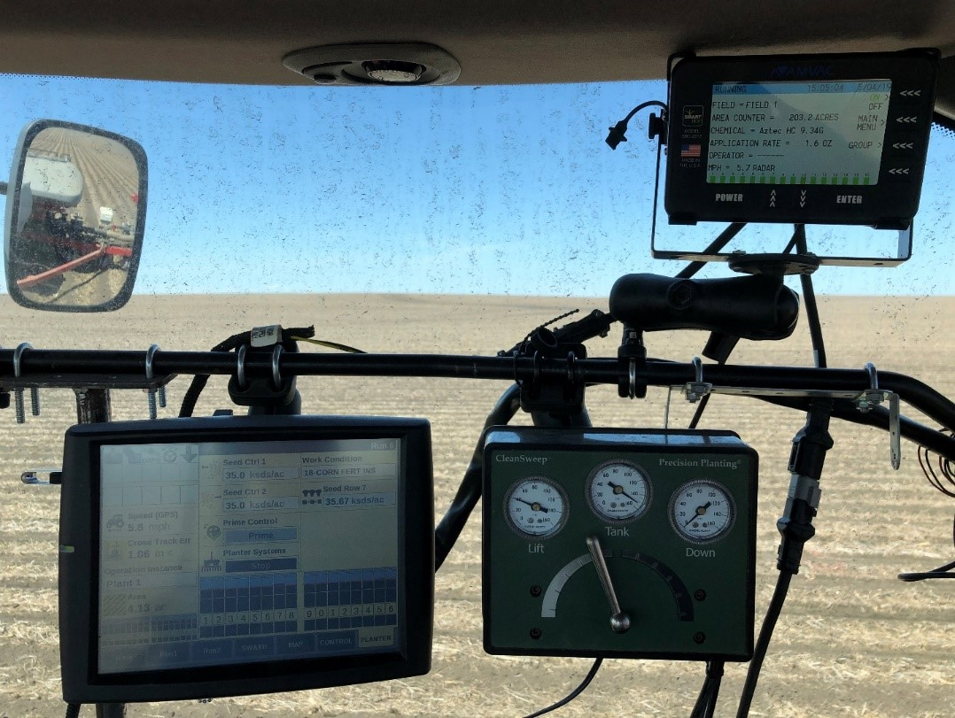 Various planter monitors and controls. The same interface is used for the planter as the strip-till. The clean sweep allows me to adjust on-the-go residue managers that clear the crop row. Photo credit: Tom Oswald