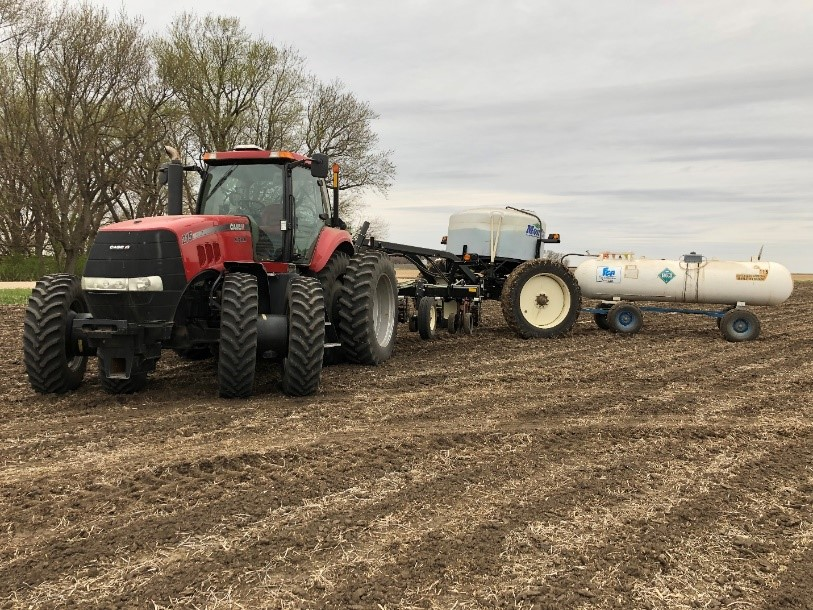 "My strip-till rig. It's a long train with two forms of fertilizer representing three nutrients, that are injected about 6-8"" deep in rows 30"" apart. The corn will be planted directly over these rows of fertilizer. Photo credit: Tom Oswald"