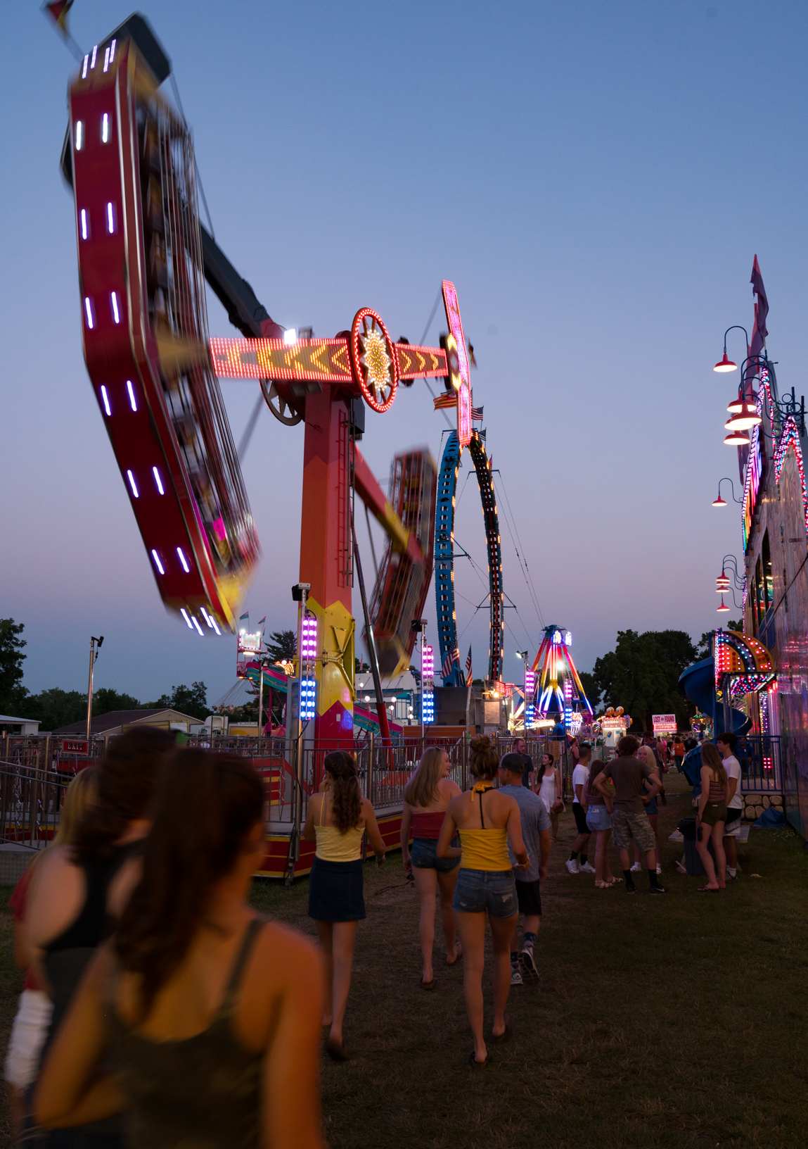 Midway rides light-up the night sky as teenagers enjoy the Jones County Fair in Monticello. Photo credit: Joseph L. Murphy/Iowa Soybean Association