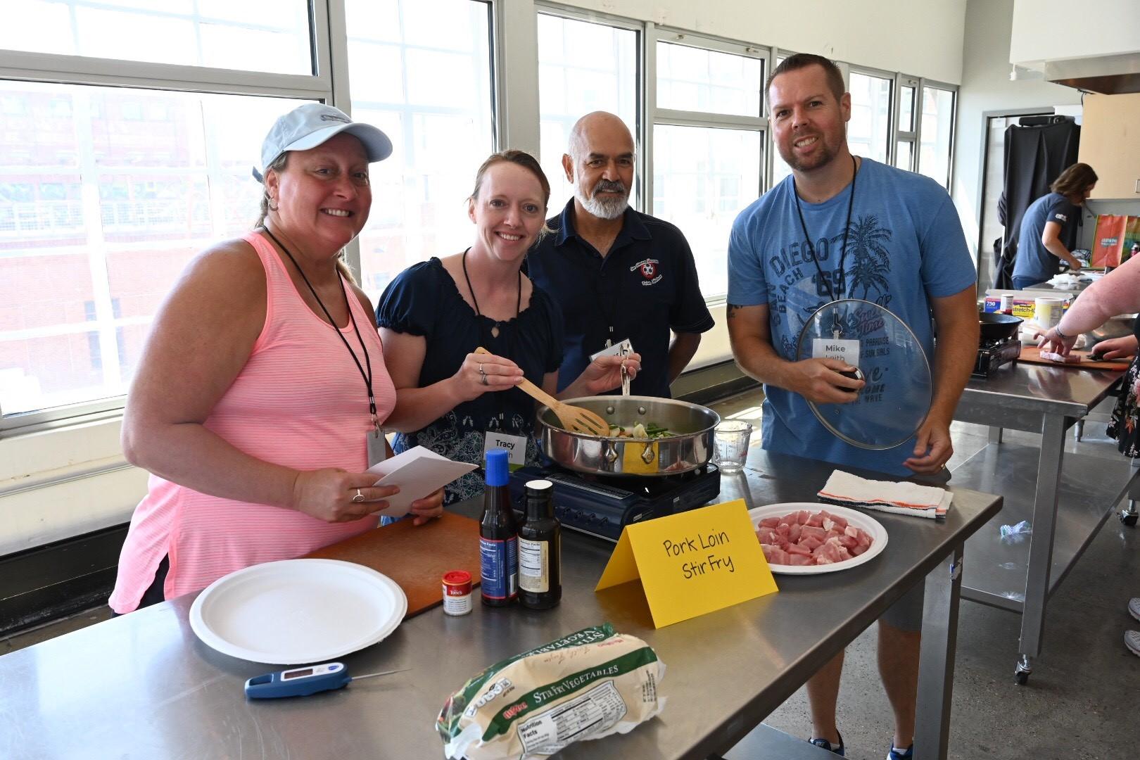 Food U participants prepare pork loin stir fry. Photo credit: Joseph L. Murphy/Iowa Soybean Association