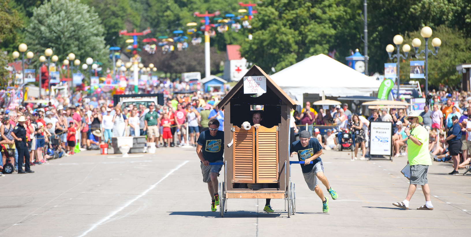 A team competes in the Outhouse Race at the Iowa State Fair while a large crowd watches on the Grand Concourse. Photo credit: Joseph L. Murphy/Iowa Soybean Association