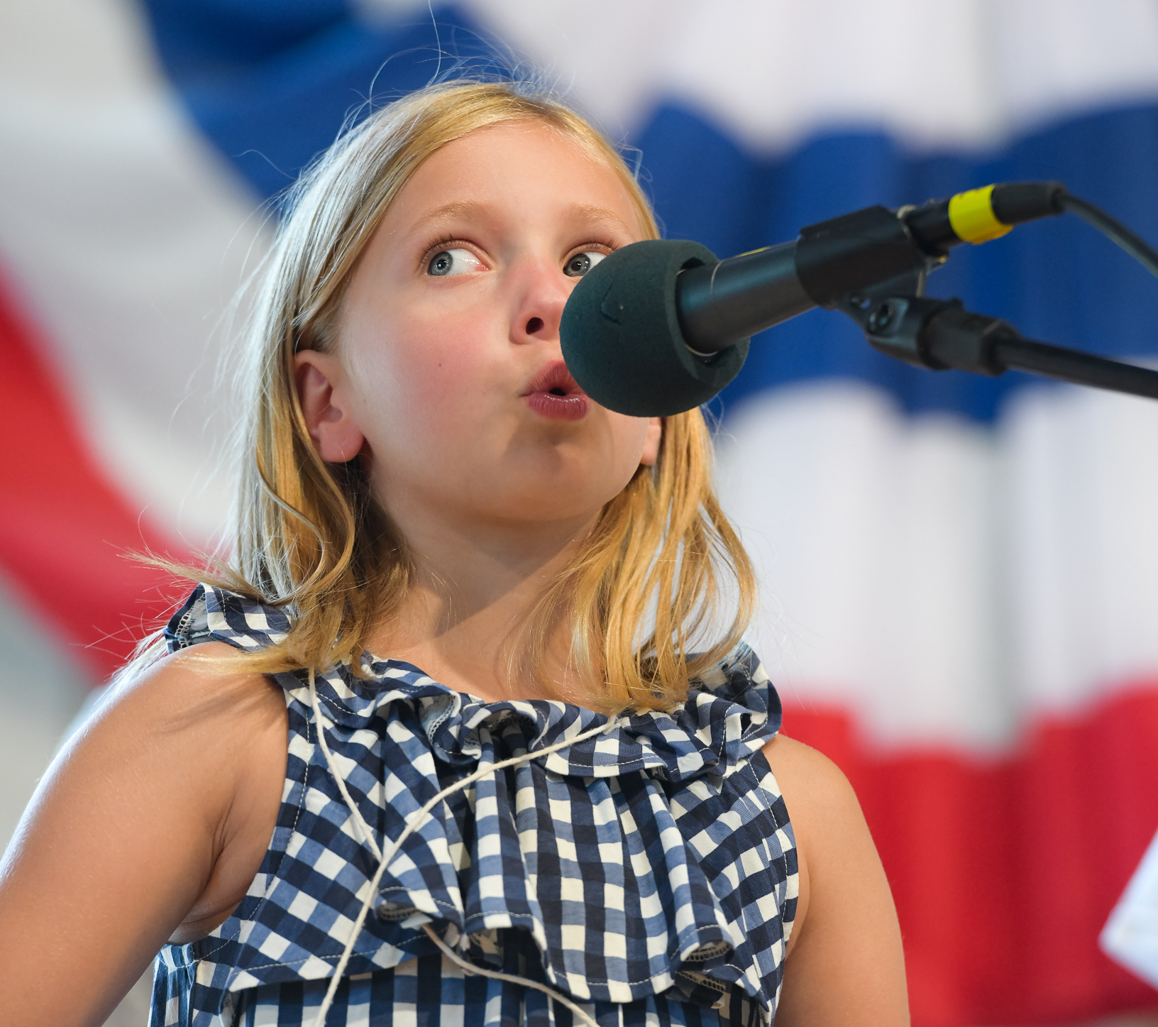 Aspen Fenton competes in the Iowa State Fair whistling contest at Pioneer Hall. Photo credit: Joseph L. Murphy/Iowa Soybean Association