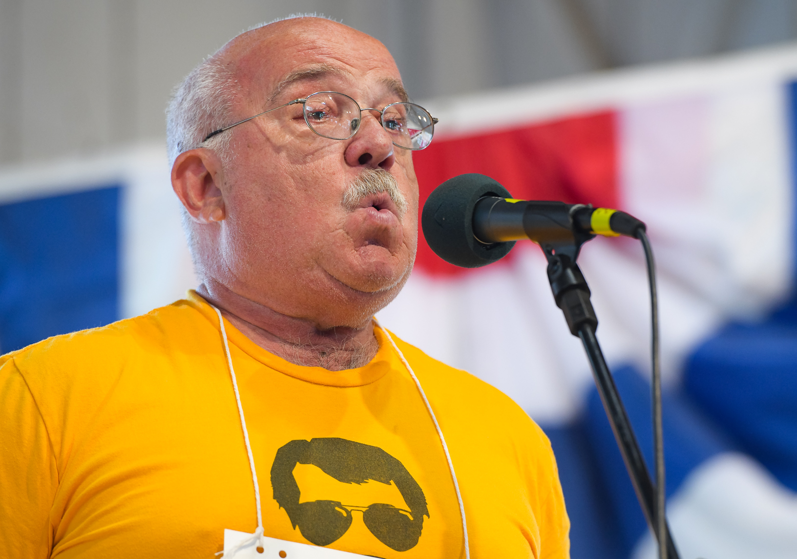 A man competes in the whistling contest at the Iowa State Fair. Photo credit: Joseph L. Murphy/Iowa Soybean Association
