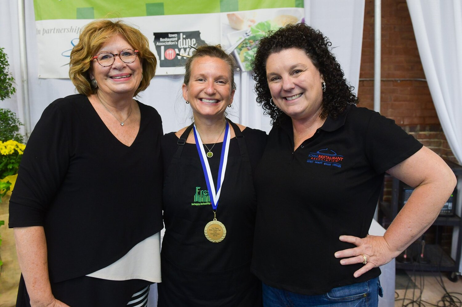 Jessica Dunker (right) poses with Linda Funk (left) and Kerri Rush (center) during the 2019 Soyfoods Salad Dressing Competition at the Iowa State Fair. Photo credit: Joseph L. Murphy/Iowa Soybean Association