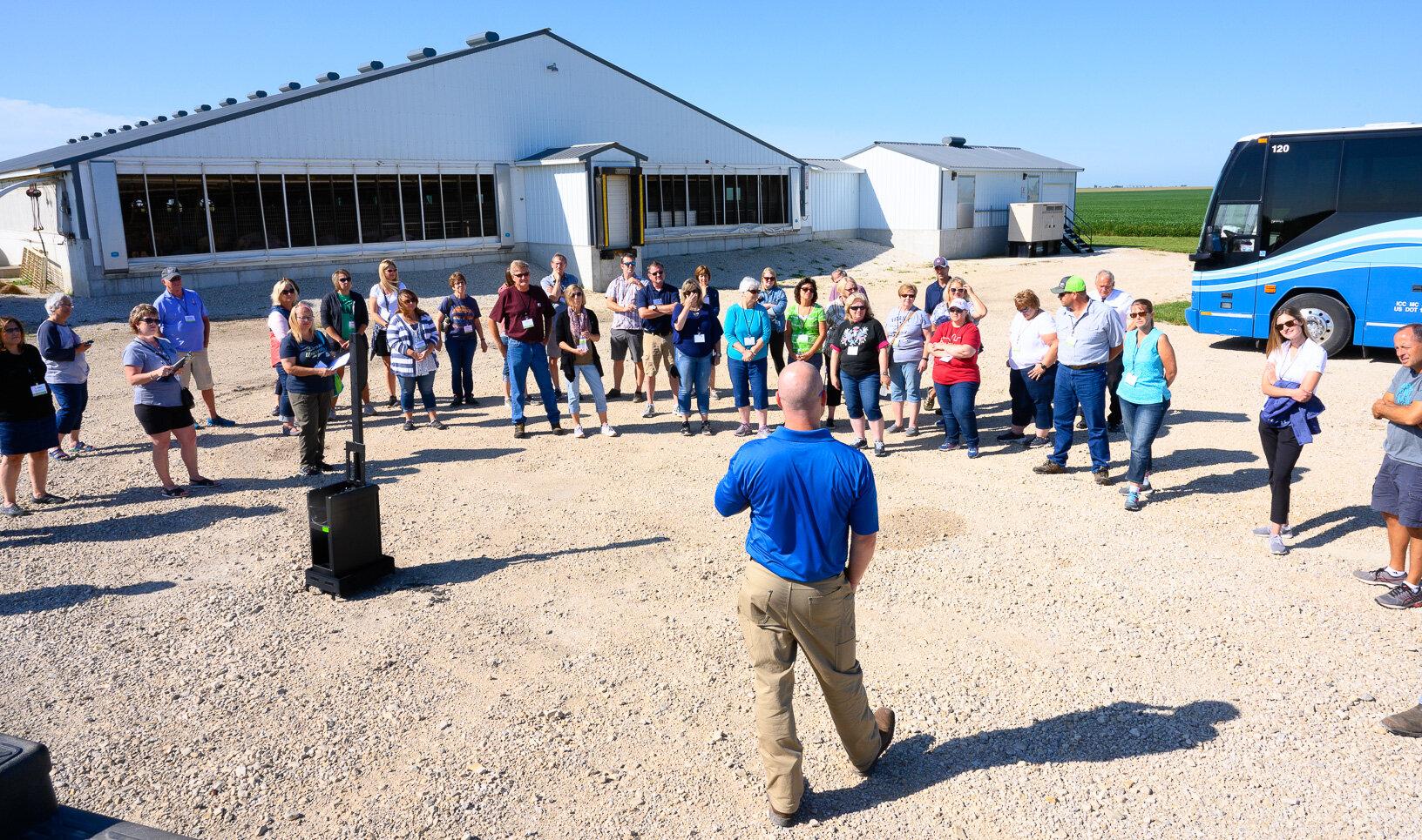 Jonathan Wetter welcomes participants to his farm. He explains how he raises pigs in a modern 2,400-head barn. Photo credit: Joseph L. Murphy/Iowa Soybean Association