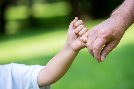 July 26 37384825_S_Child_Holding Finger_Hand.jpg