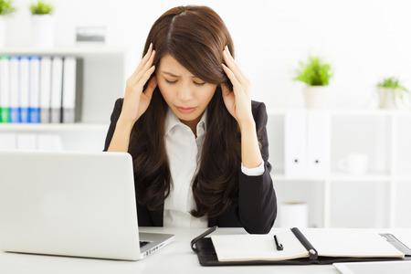 34643602_S_sad_stressed_woman_working_computer_harrassment.jpg