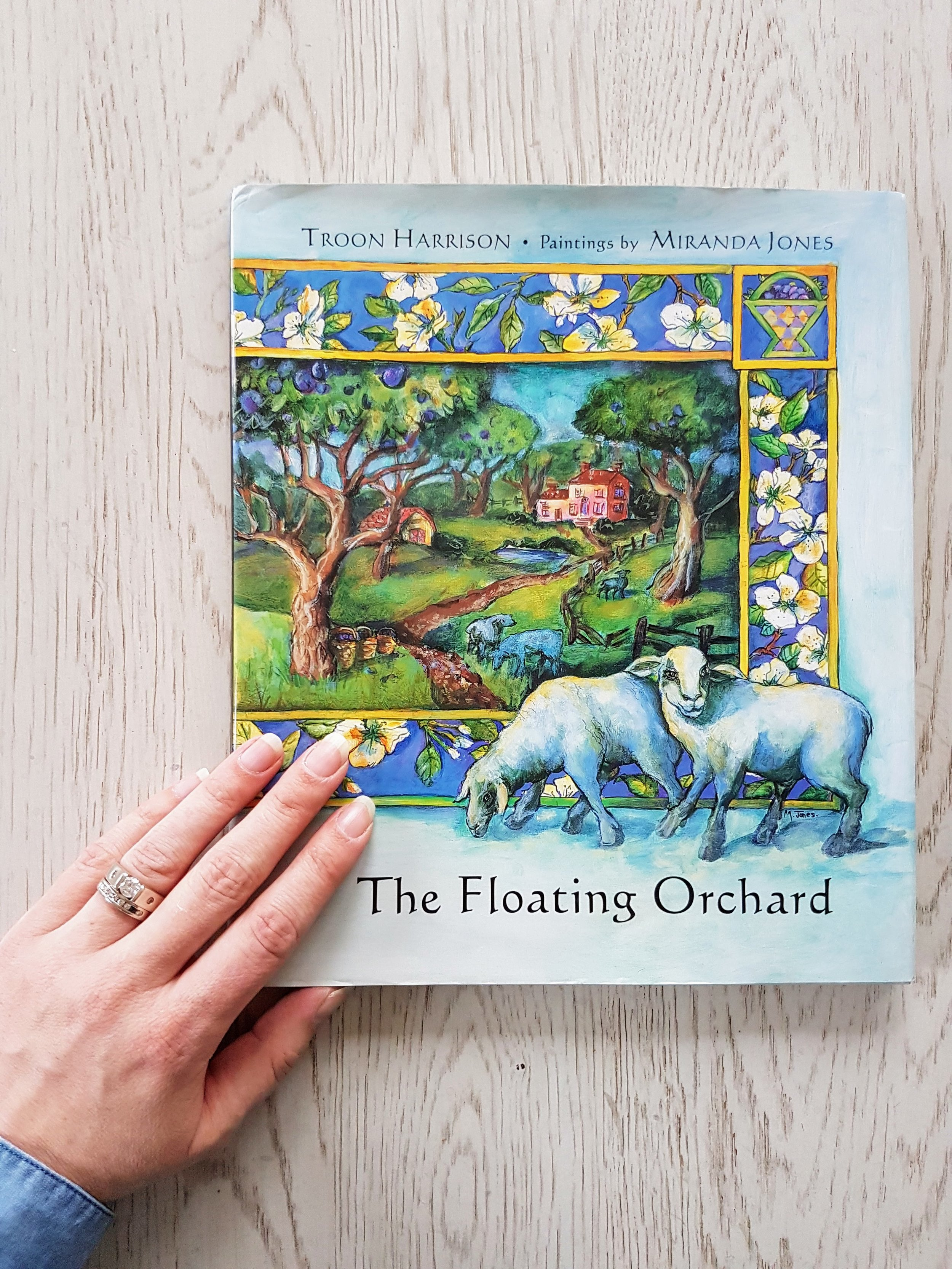 """""""The Floating Orchard""""  is a book my late Grandma Kardash gave me which her friend in the artist community had illustrated and signed with a note about her hope that my grandma could share it someday with her great-grandchildren. It's a beautiful story about loss and hope."""