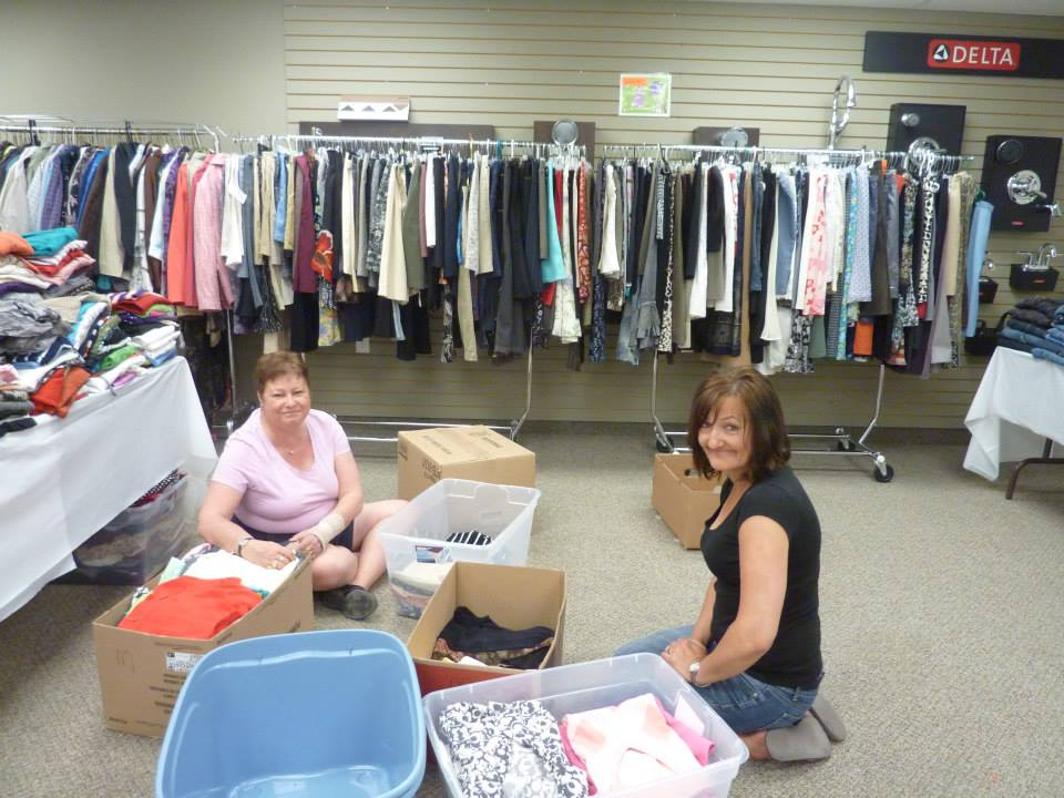 Volunteers sort through donations. Photo from the Dress For Success website.