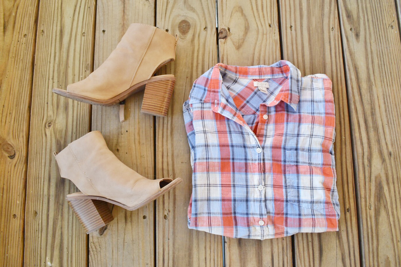 A pair of Circus by Sam Edelman brand tan, leather, heeled booties with a J.Crew brand plaid popover shirt.