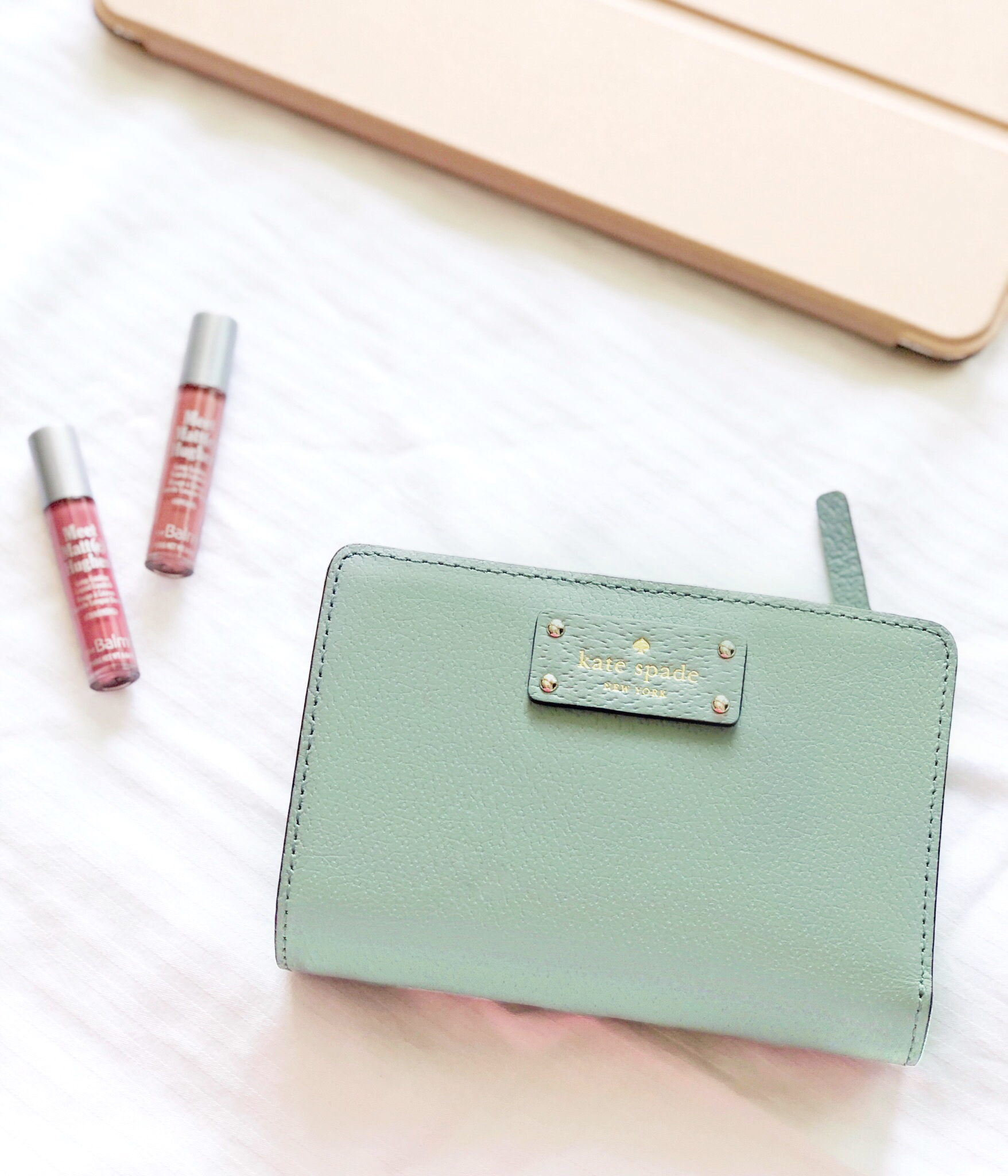 Pictured:  Kate Spade Wallet ,  Meet Matt(e) Hughes Lipstick,   Moko iPad Case  *the exact wallet pictured is no longer in stock - I linked a similar one.