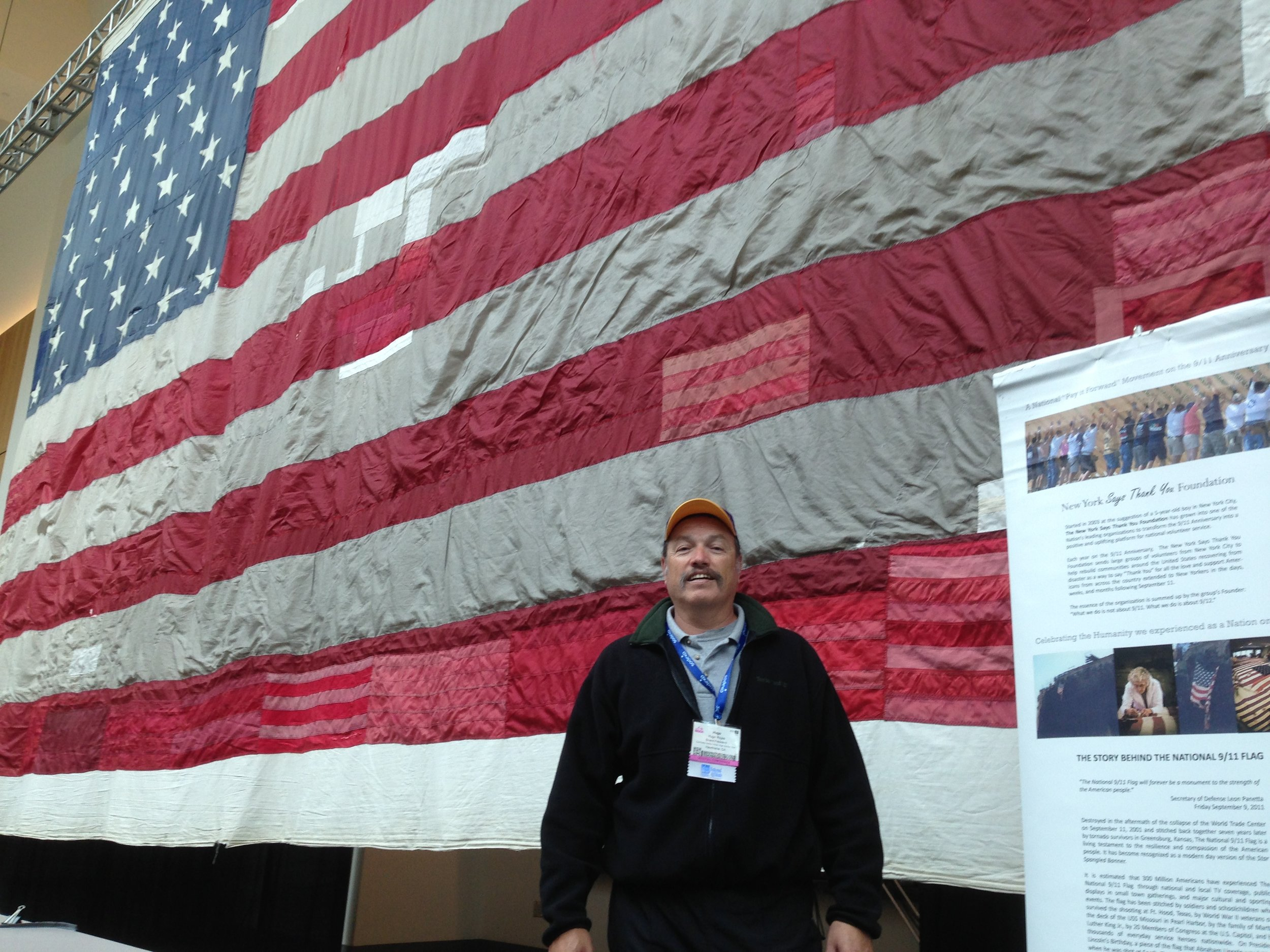 Tony with the 9/11 Memorial flag in New York City
