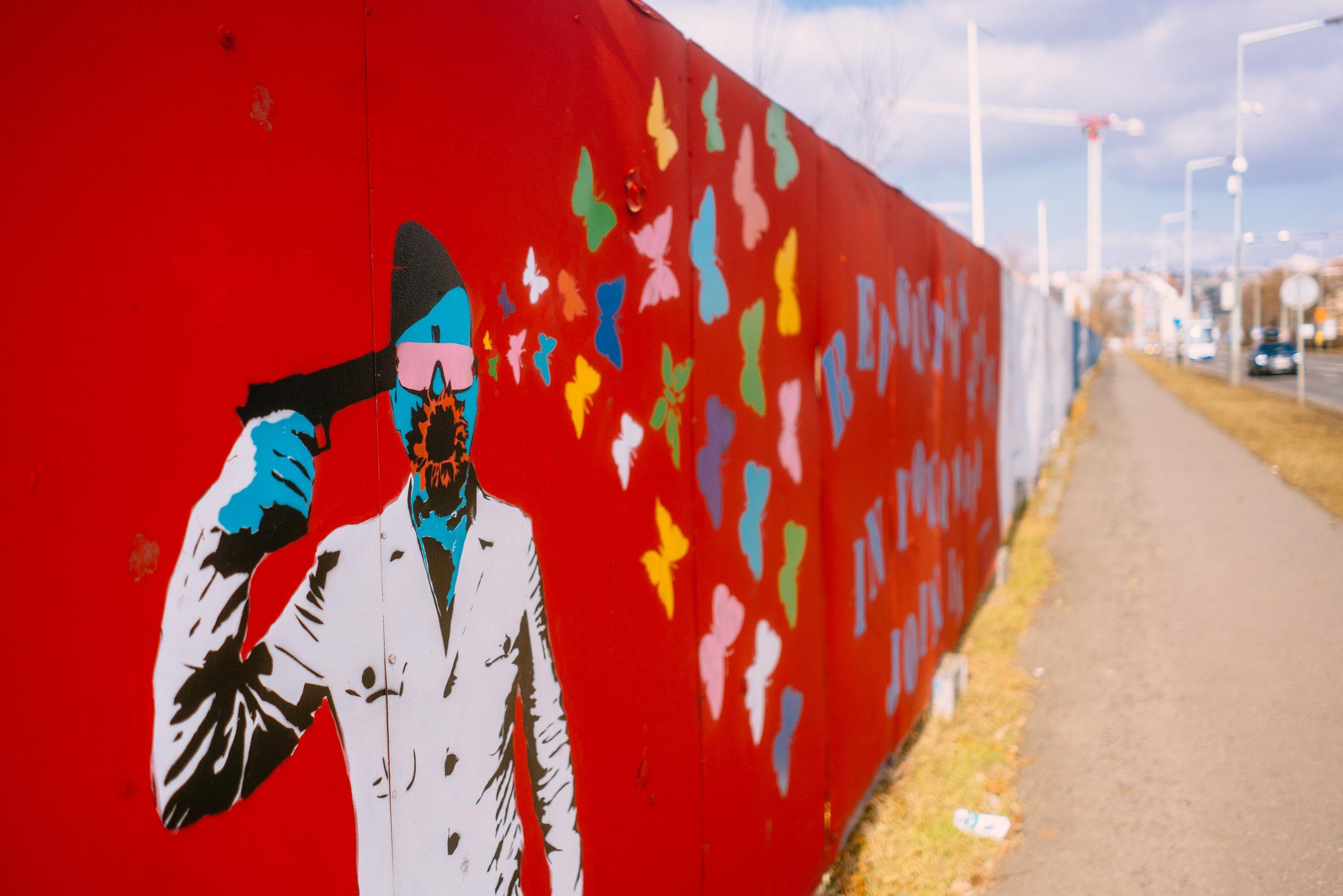Street art in Prague, butterfly gun