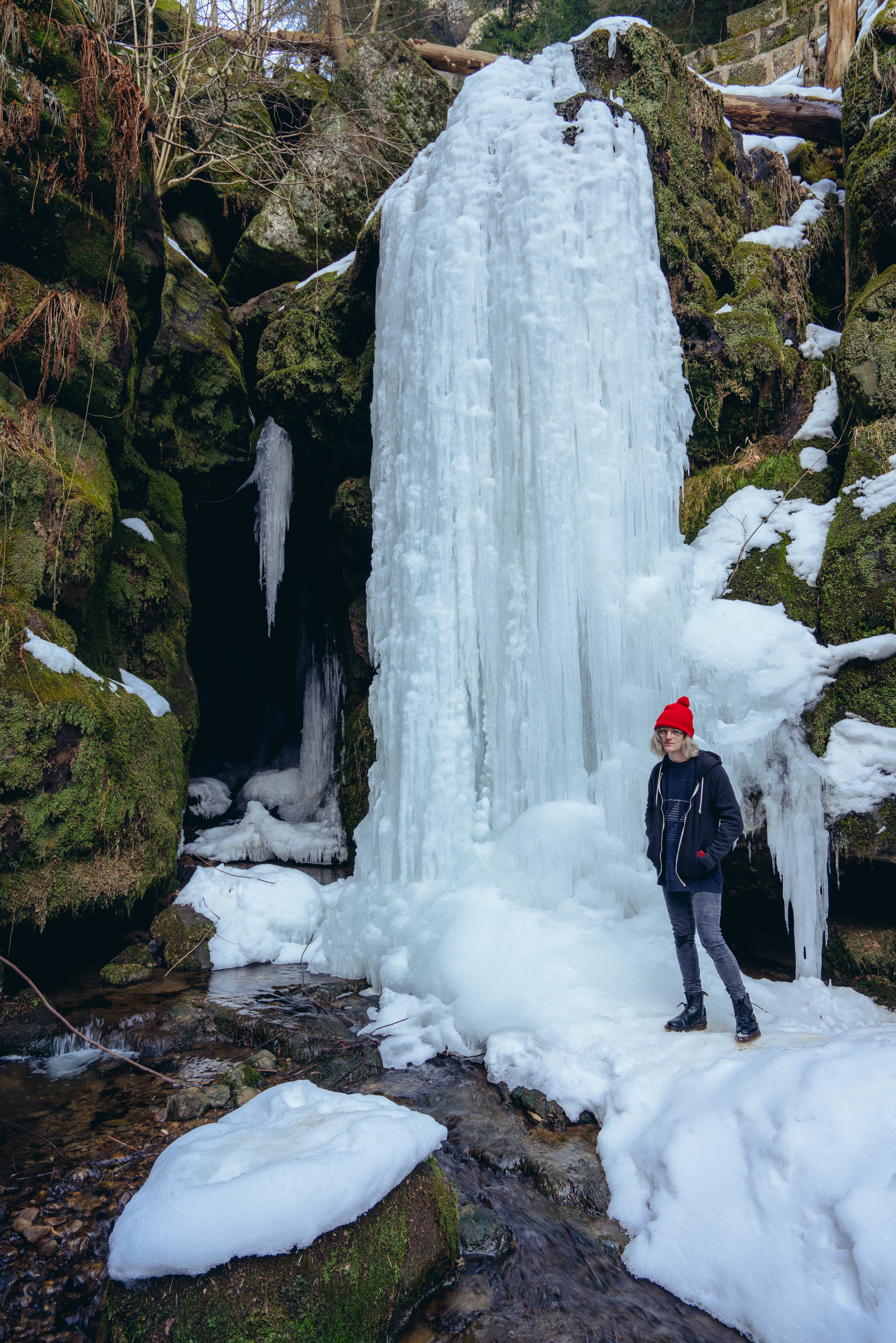 Standing next to a frozen waterfall in Saxon Switzerland