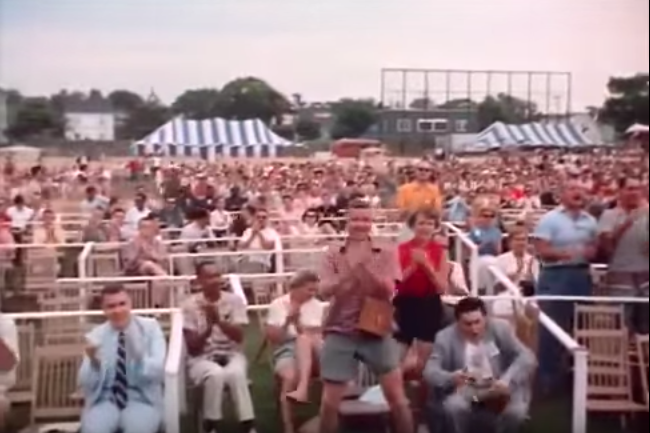 Karl & El Woodman, standing, and Bill Lacey seated to the left, applauding Anita O'Day's set at the 1958 Newport Jazz Festival (from the film  Jazz on a Summer's Day,  25:35).