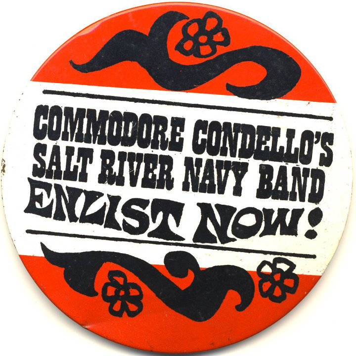 A button for Mike Condello's parody band that I got at the Fox Christown Theater in Phoenix in 1967, where I used to meet my friend Sara Ben-Shalom for Saturday morning movies and a stage show by Wallace & Ladmo, Pat McMahon, and Condello   https://www.youtube.com/watch?v=tdYQZrJTszo.