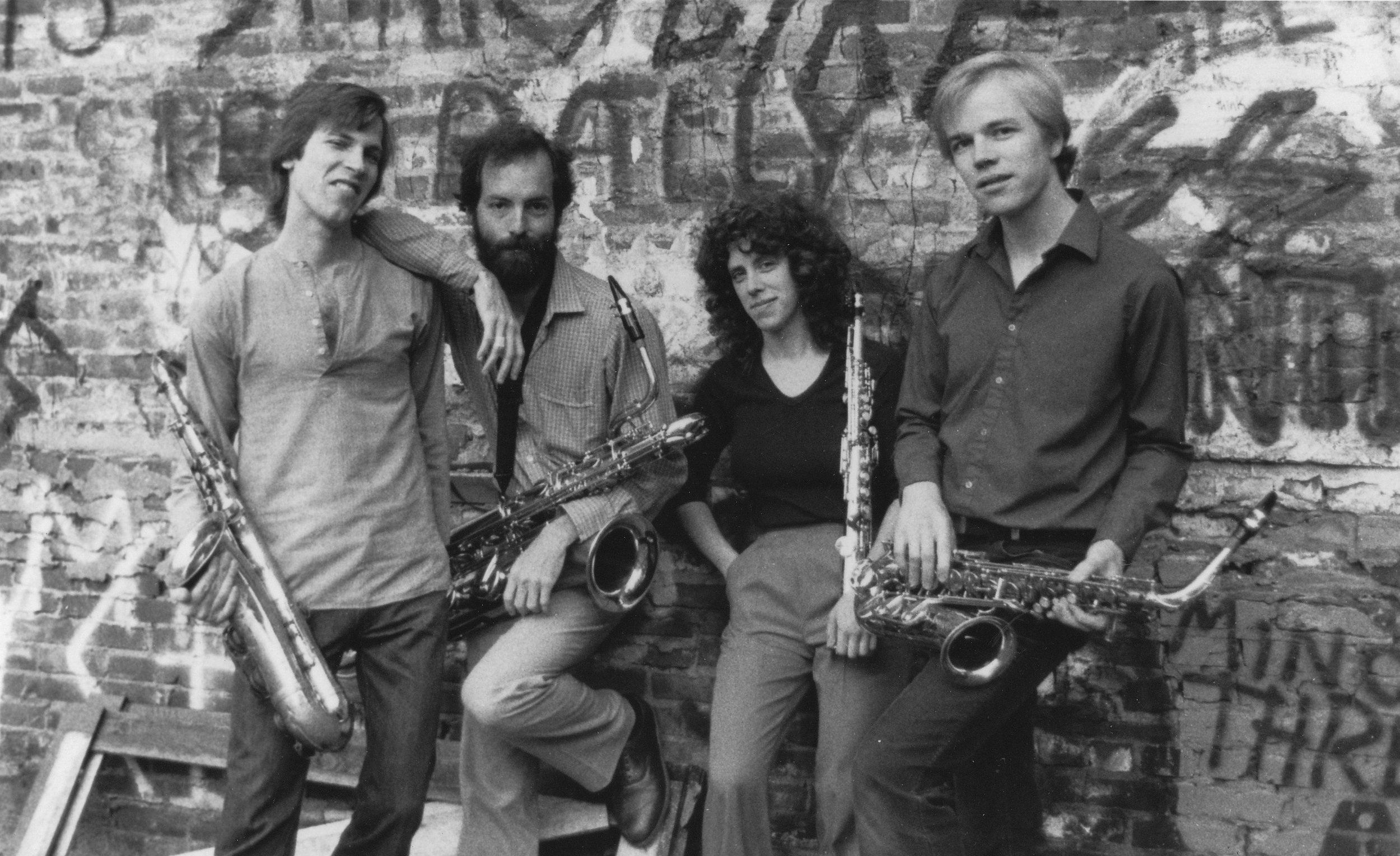 L to R: Tom Hall, Steve Adams, Cercie Miller, Allan Chase, near Gallery East, Boston, 1982.