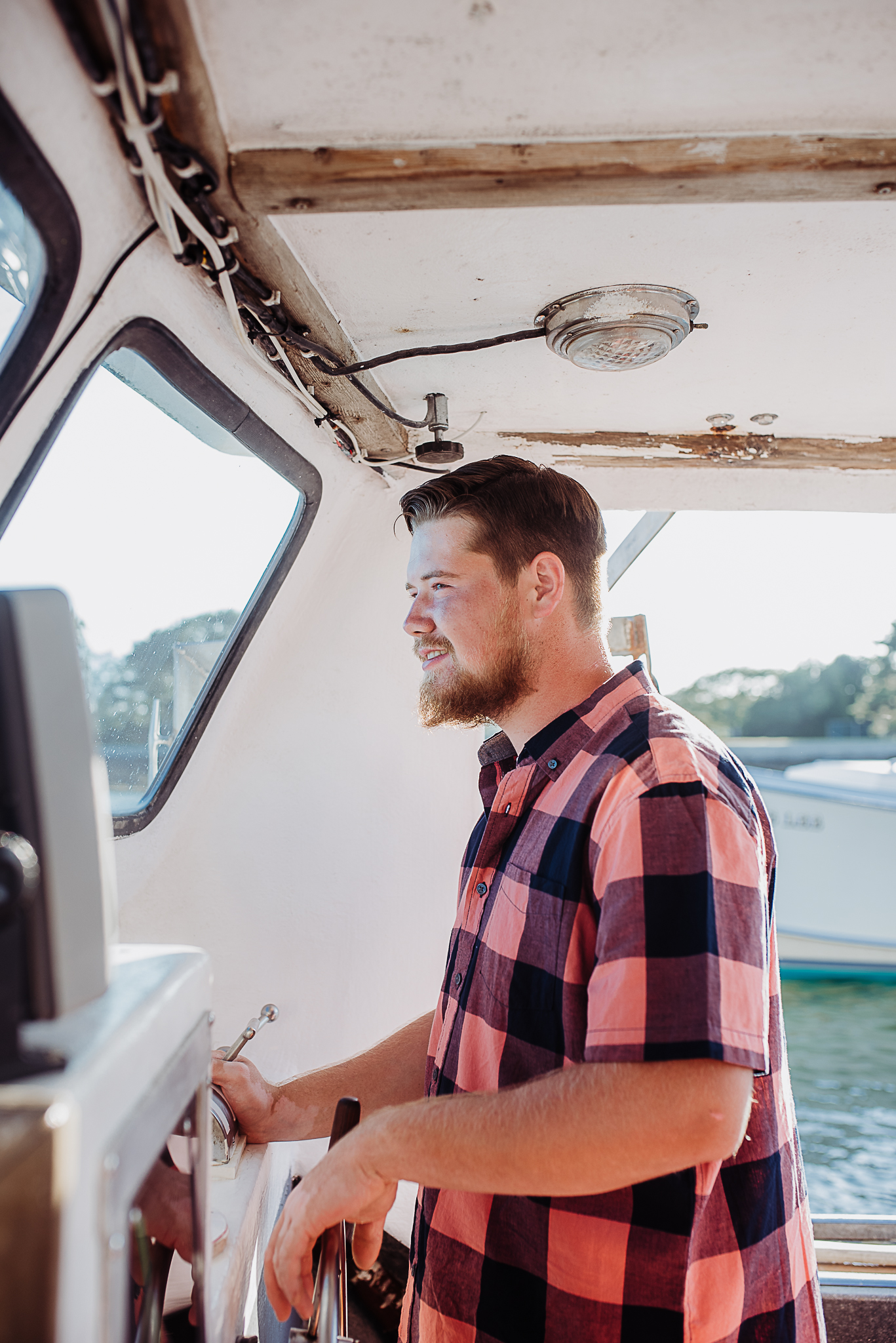 Thomas at the helm of CENTERFOLD, docked in Harpswell, Maine
