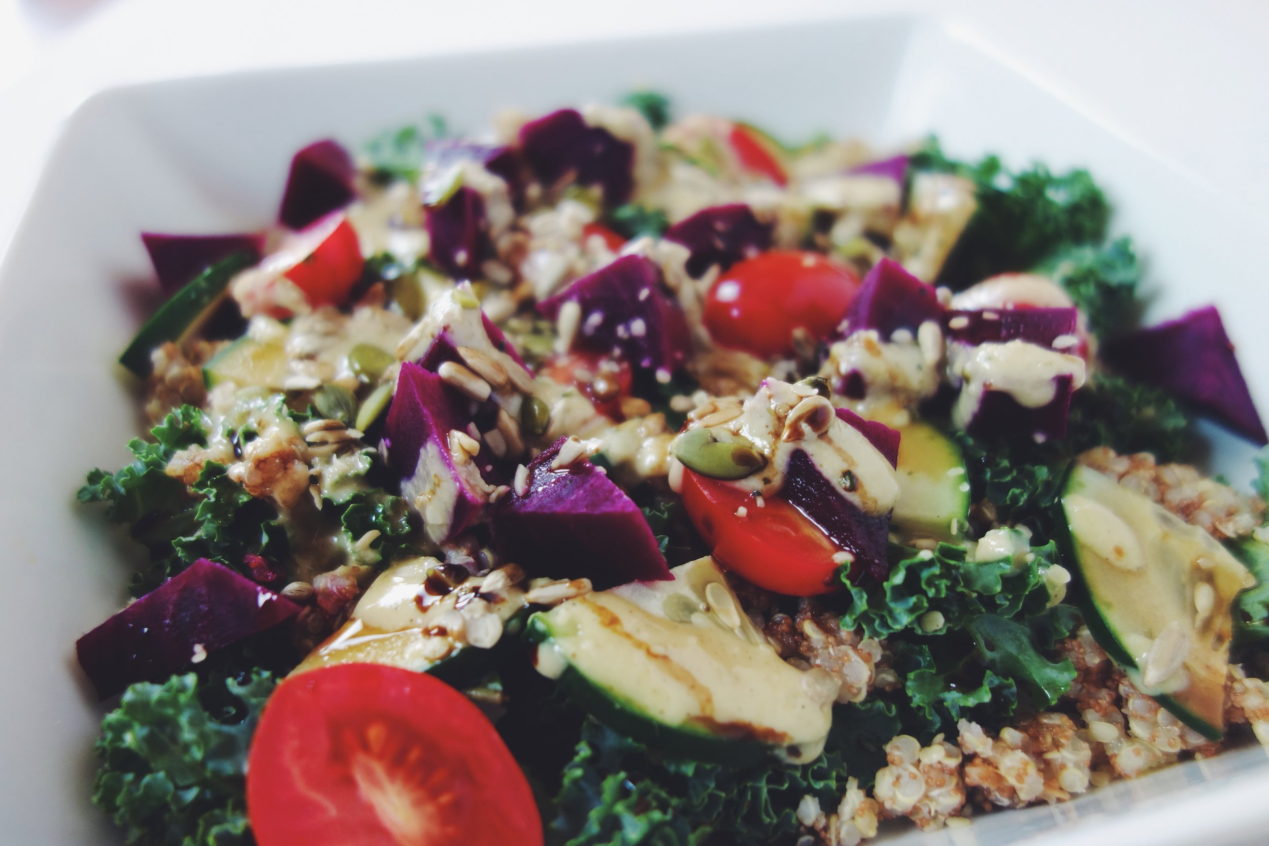 Kale, quinoa, cucumbers, cherry tomatoes, pickled beets, pumpkin & hemp seeds, drizzled with a blend of tahini, lemon juice, and olive oil. Uffda.