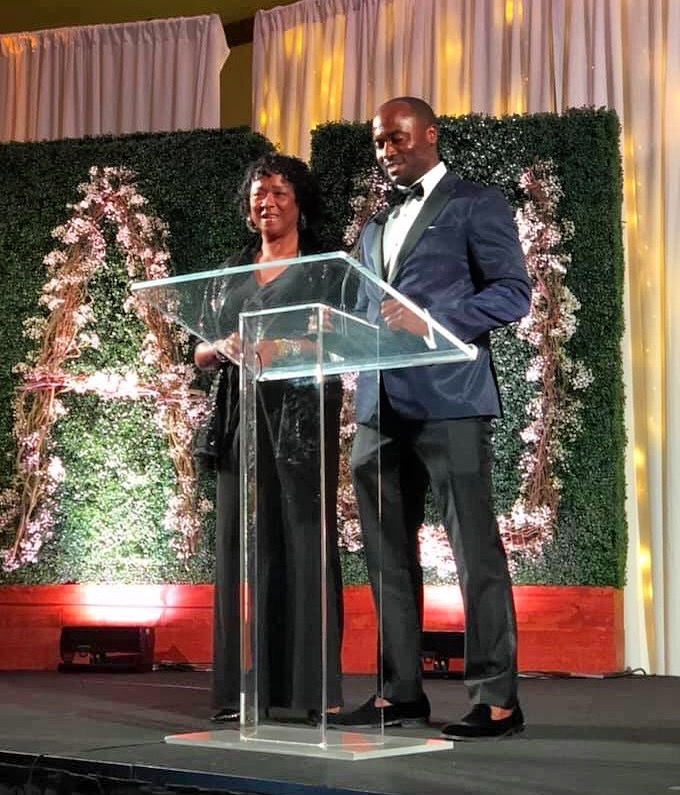 Bingham Group founder and CEO A.J. Bingham presenting the Civics, Government & Public Affairs award with this mother, Toni.