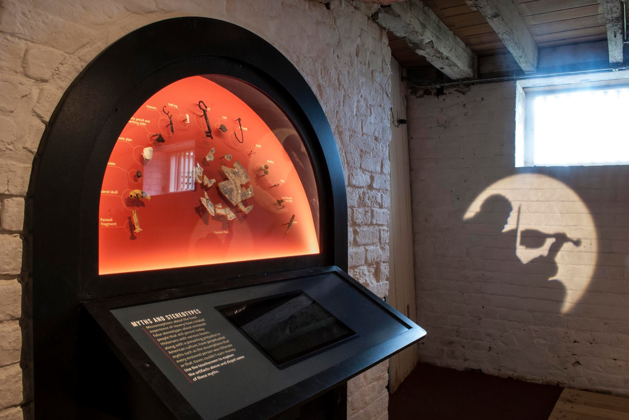 Built to fit into a basement hearth, this display features artifacts uncovered on the property, a piece of the day to day of a slaves life.