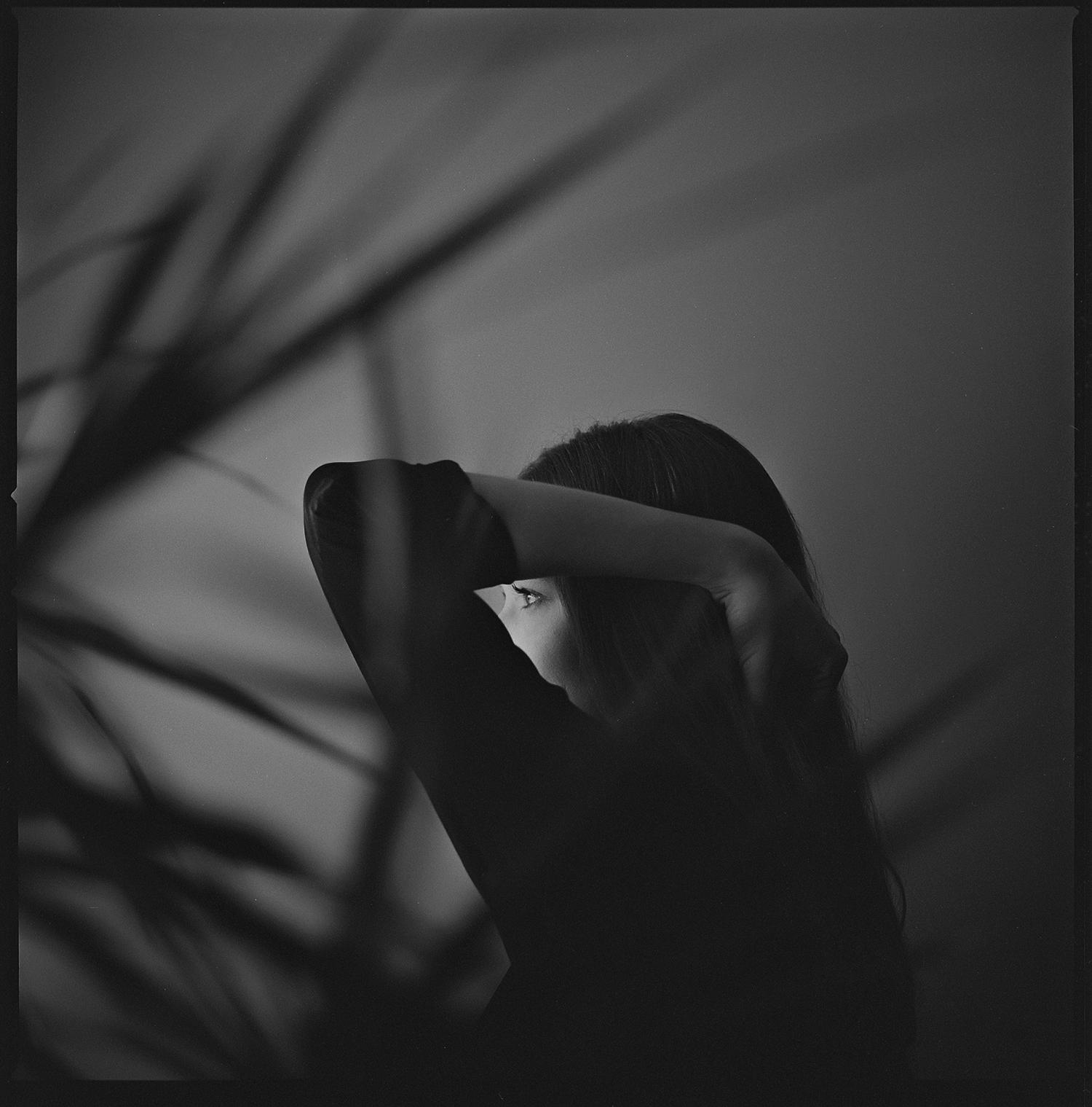 Janette-Through-Fern-Portrait-Window-Light_Kodak-TriX.jpg