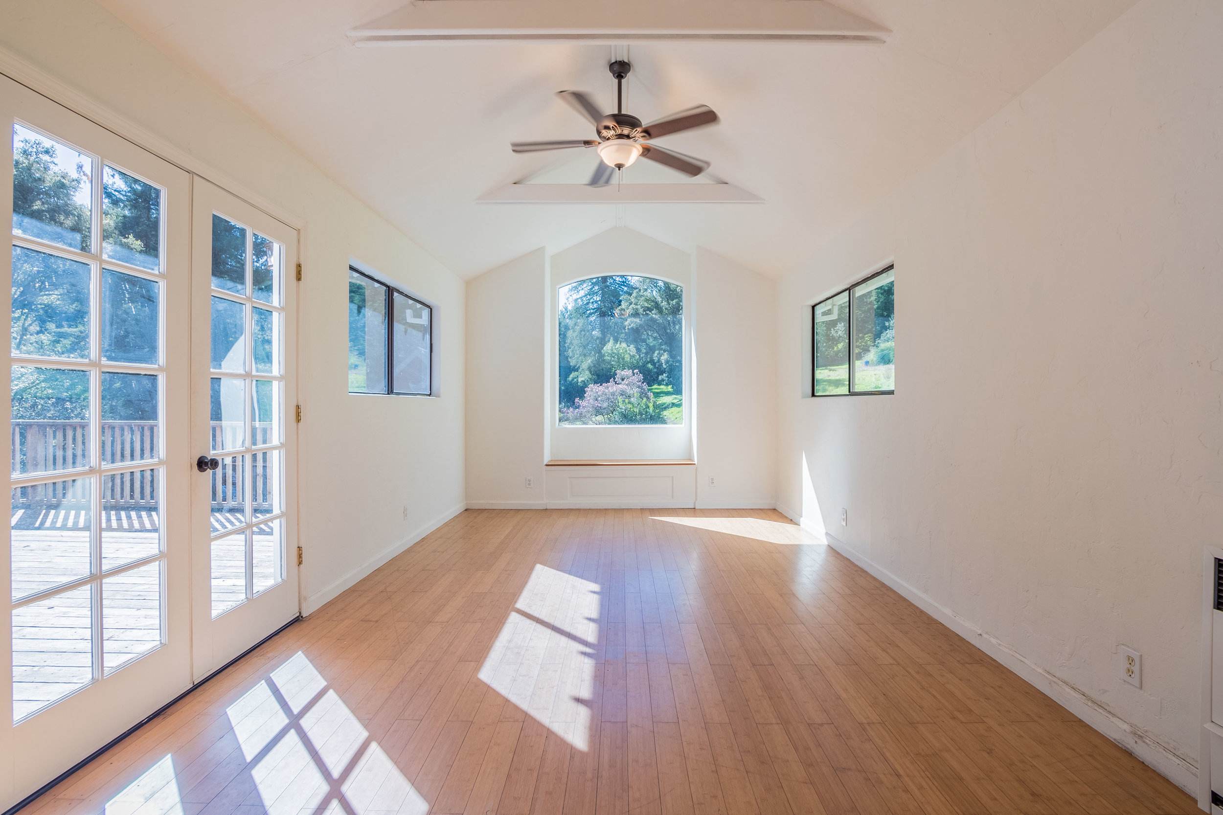Natural Light and Hardwood Floors in Living Room