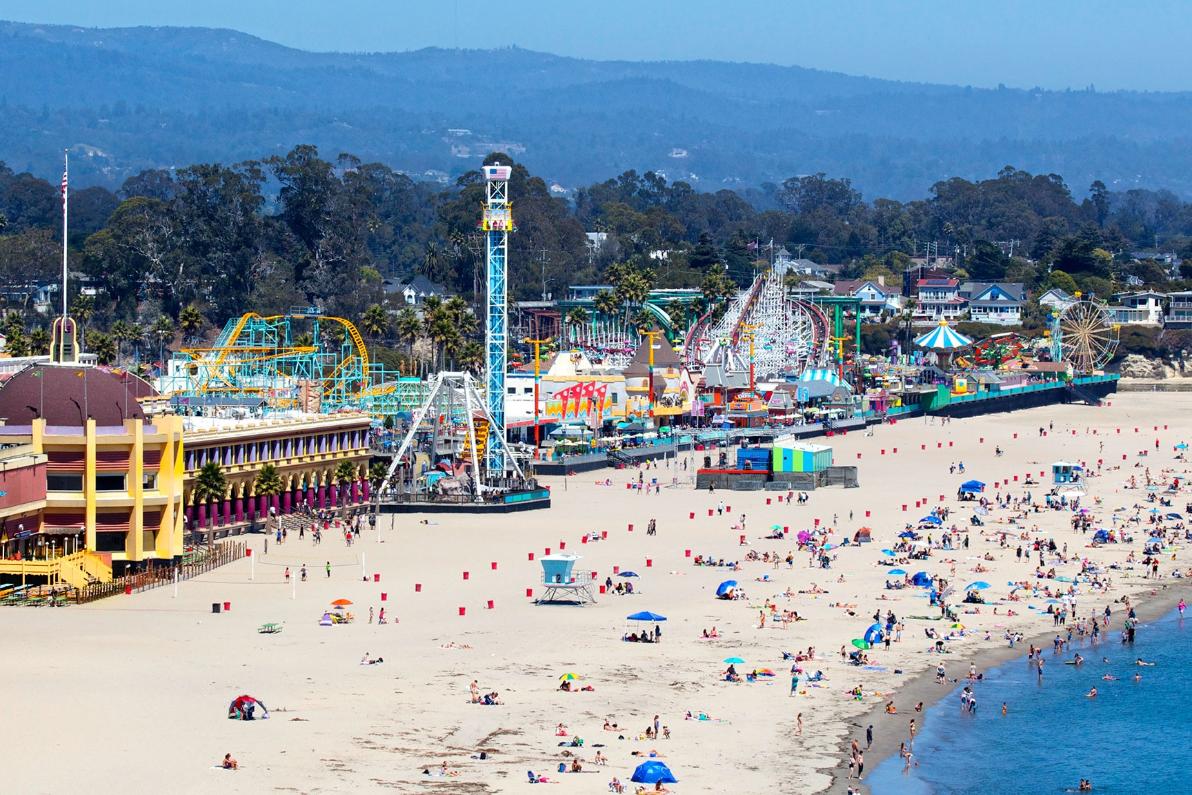 santa cruz beach boardwalk - You can't talk about the attractions of downtown Santa Cruz without mention the Beach Boardwalk, our own seaside amusement park. Aside from the rides and carnival snack foods, there's also an arcade, miniature golf, and a free summer concert series. The Boardwalk is home to two rides that have the designation of being a National Historic Landmark, the Giant Dipper and the Looff Carousel. The Giant Dipper is one of the oldest wooden roller coasters in the world that's still in operation, having been first built in 1924. The Looff Carousel is an old fashioned merry-go-round which first opened in 1911.