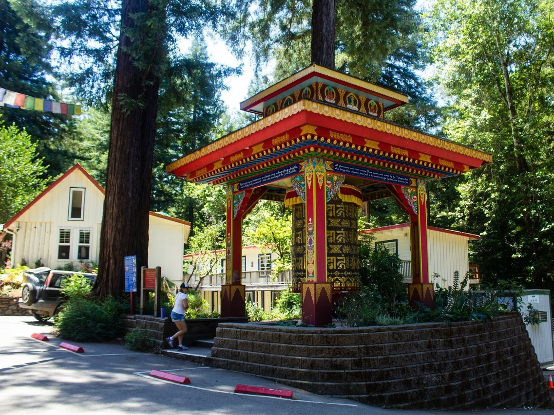 land of medicine BUDDHA - Looking for a place to hit refresh? Then you may want to look into Land of Medicine Buddha, an environmentally conscious meditation and retreat center on 108 acres in the Santa Cruz Mountains. While Land of Medicine Buddha is an active Buddhist community, they invite you to come and explore their sacred center which includes miles of hiking trails within the redwood forest.