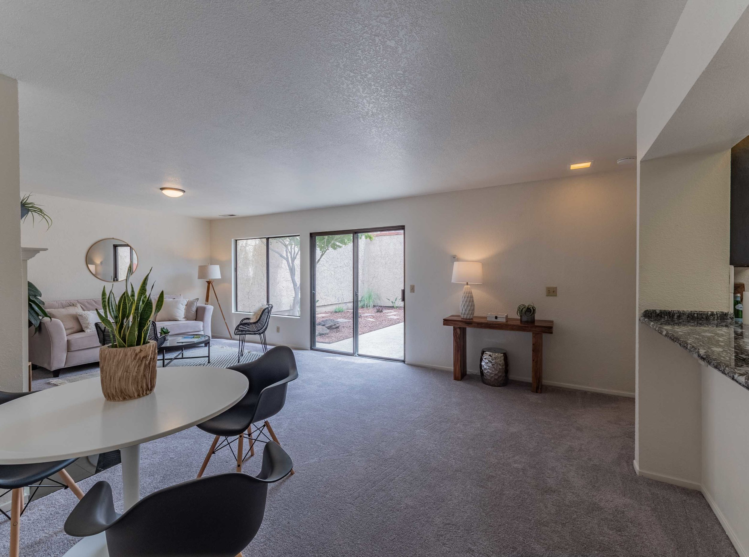 Conveniently located just a stone's throw away from Swift Street Courtyard, this clean single-level home with new paint and carpet, is ready for you to move in! Natural light fills the private courtyard, open living room, and tastefully updated kitchen. The large two-car garage allows for plenty of storage space. Located about a mile from the UCSC entrance, this property has a strong rental history. A great fit for a first time home buyer, growing family, investor, or someone looking for that easy second home⁠—come take advantage of this well-priced property! 