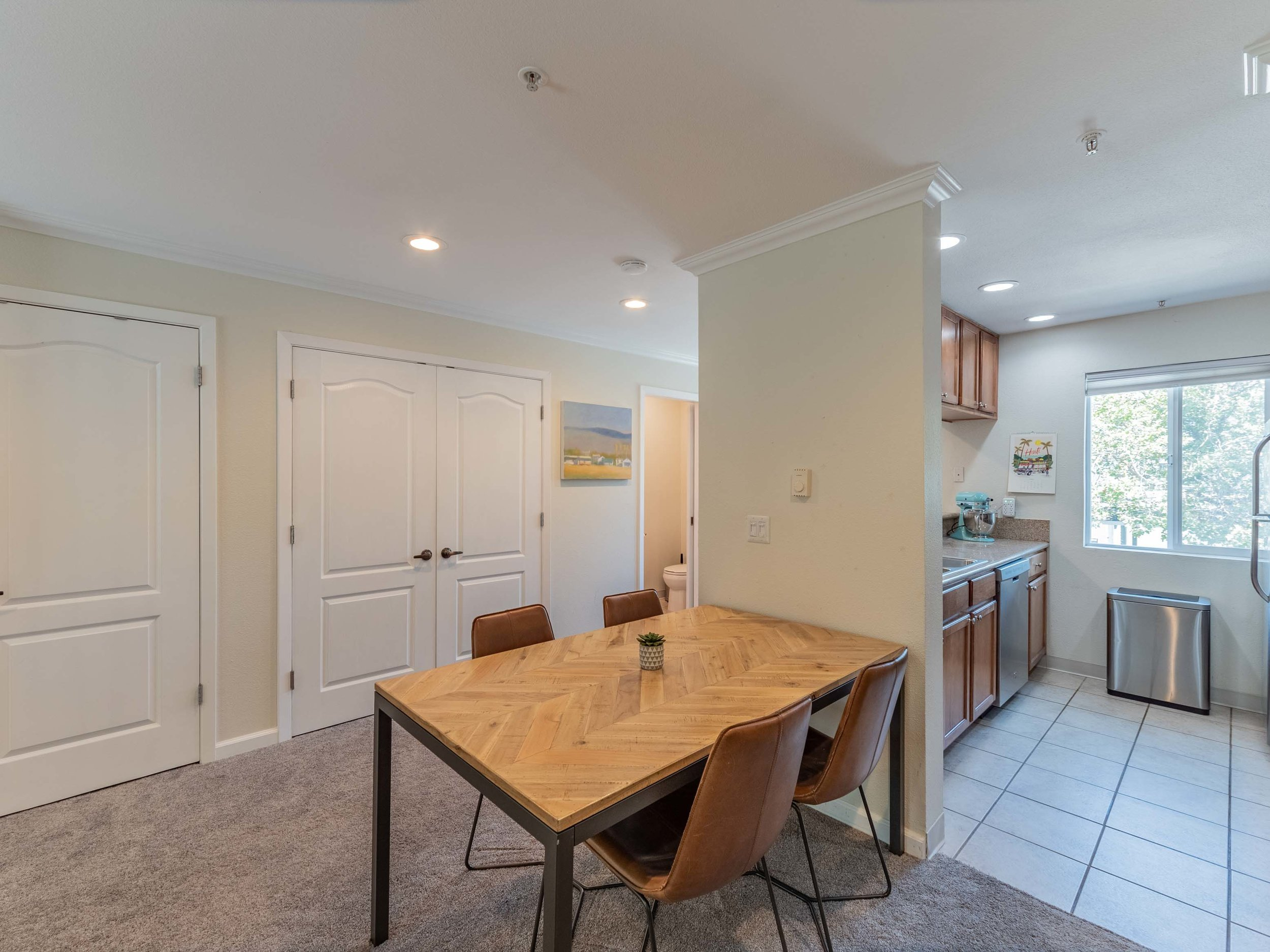 Spacious living space with half bath and laundry closet