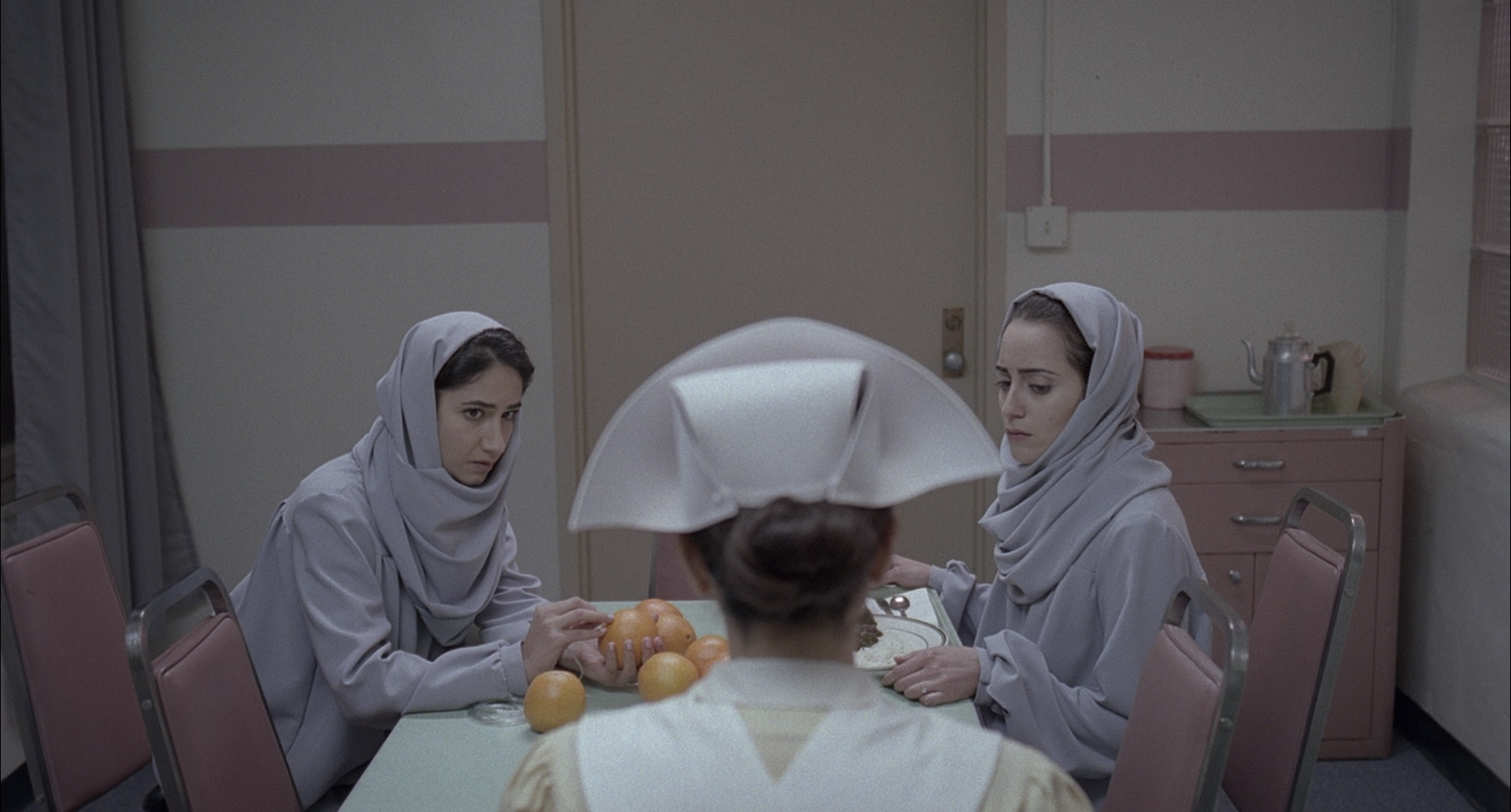 The Last Shift    Directors: Roja Gashtili, Julia Lerman // USA    A young nurse grows obsessed with a locked door in the ward where she works as a revolution unfolds beyond the hospital walls in 1979 Iran.