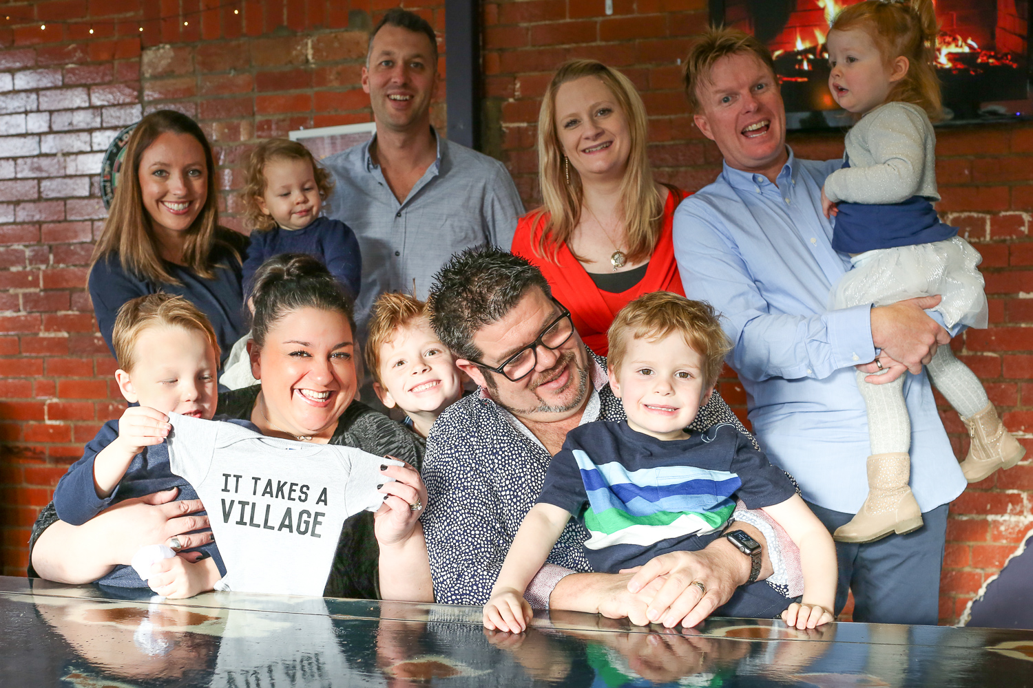 members of surrogacy journey with family at maternity photo session in Melbourne Victoria